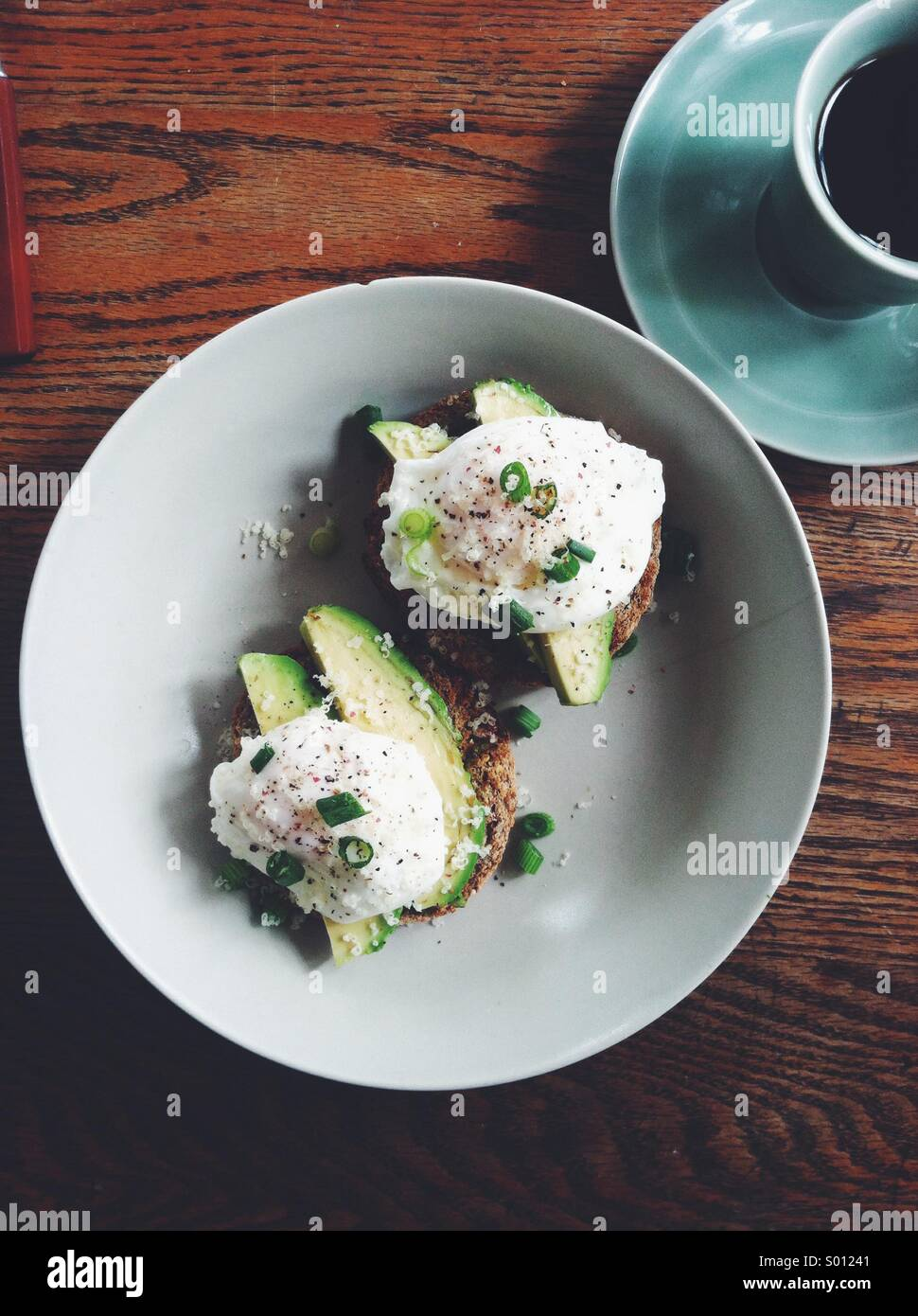 Poached eggs and avocado - Stock Image