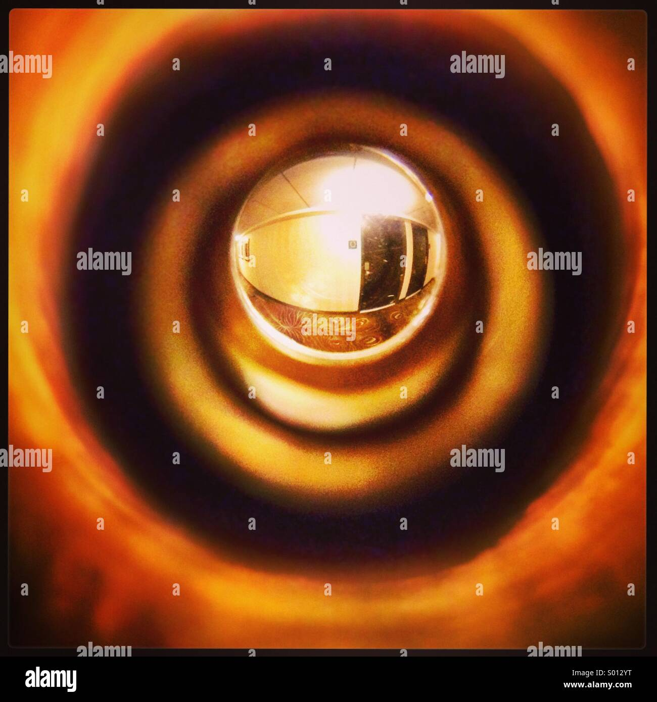A peephole view of a hotel hallway - Stock Image