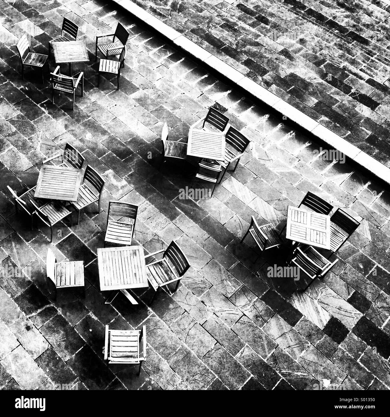 Table and chairs on the South Bank,London - Stock Image