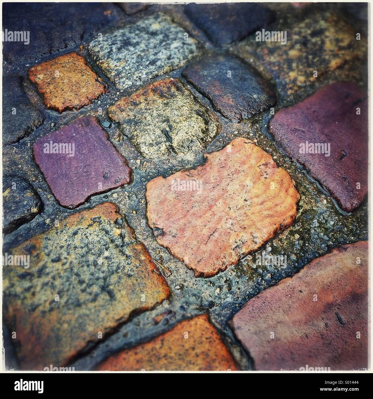 Cobblestone street detail in Dinan, France - Stock Image