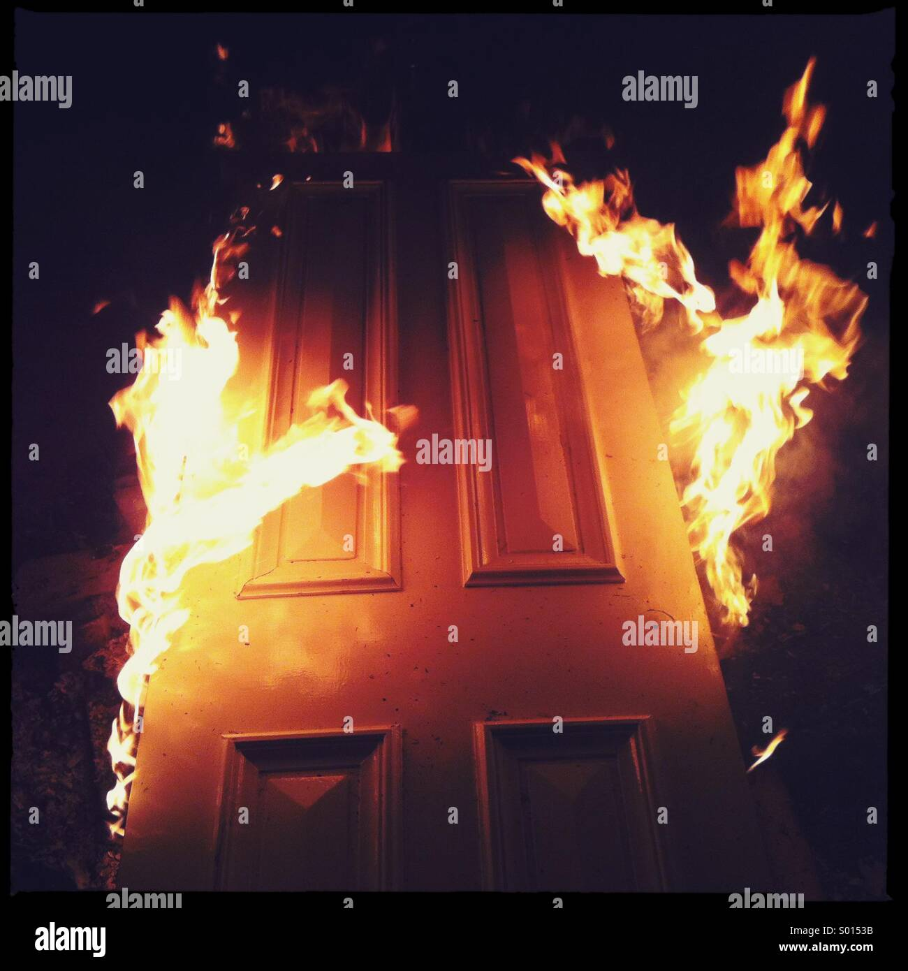 Burning door, do not enter::. Or leave - Stock Image