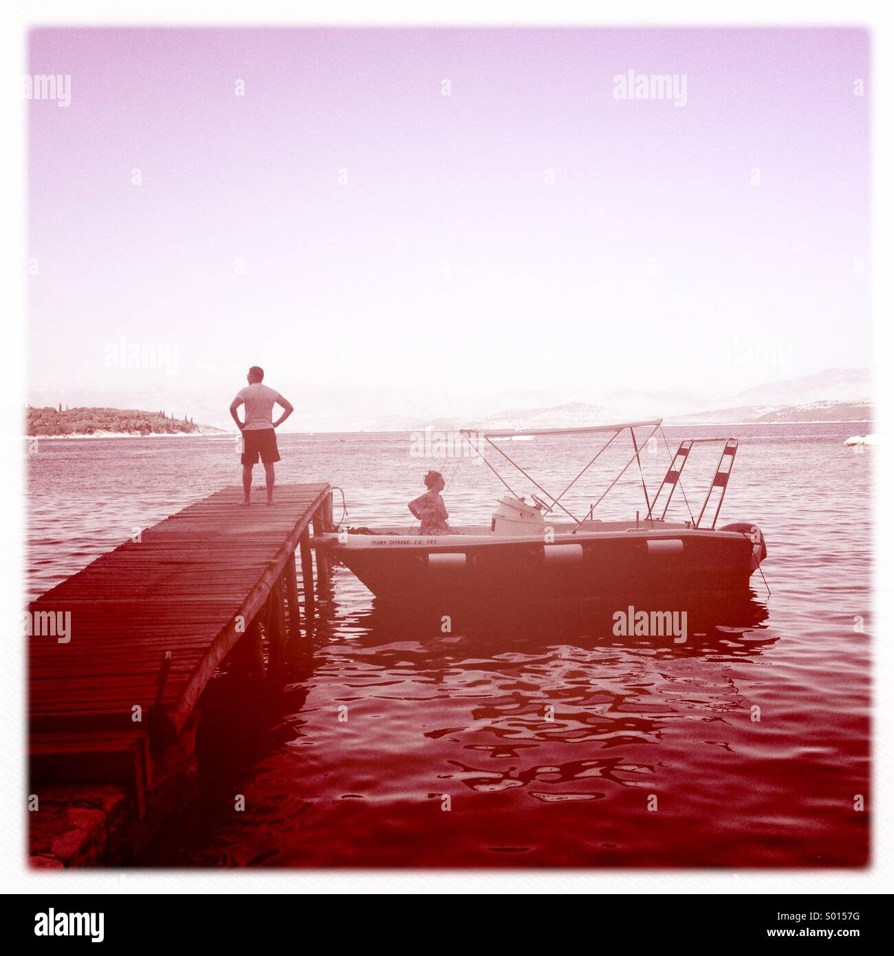 Couple moored up on jetty - Stock Image