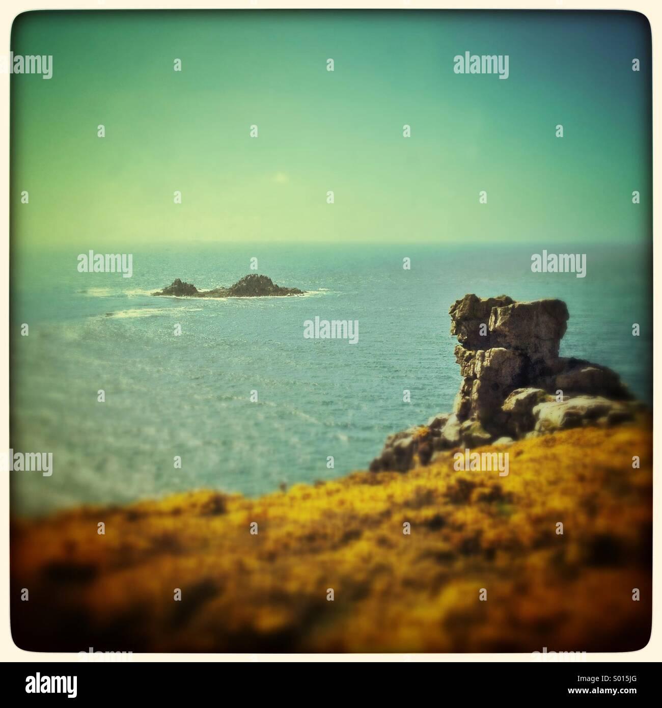 Rocks on the Cornish coastal cliff path - Stock Image