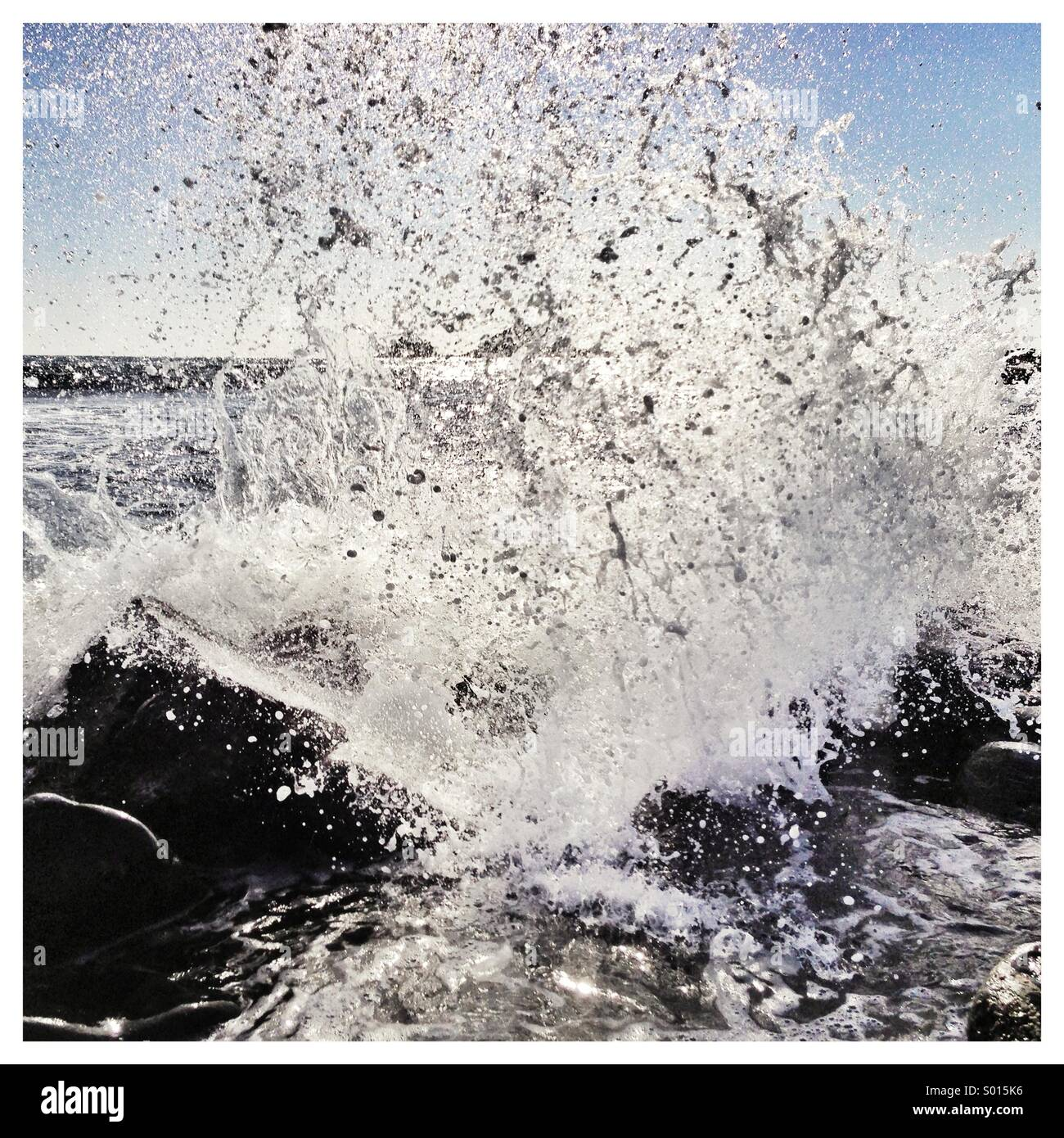 Sea crashing on rocks close up - Stock Image
