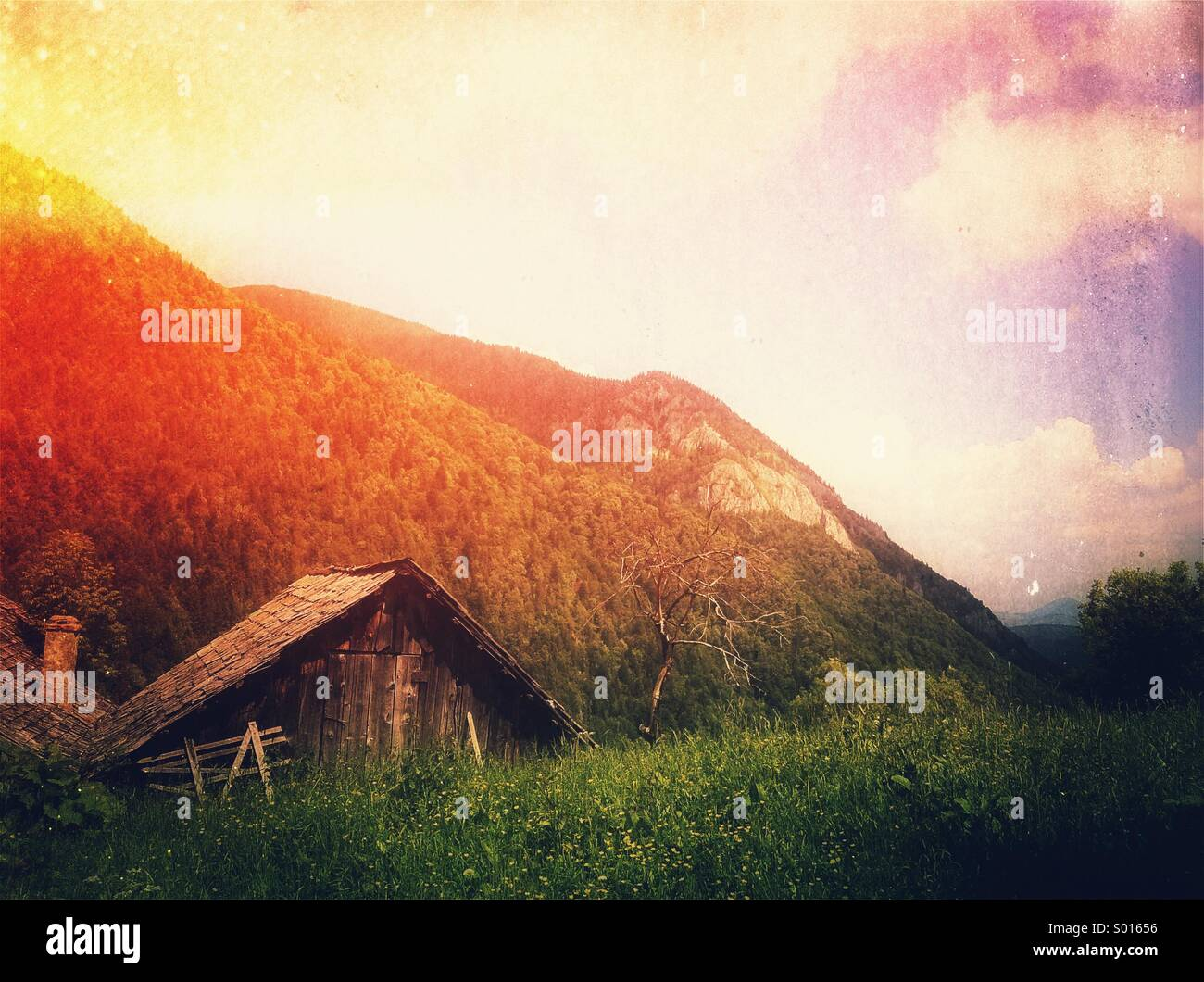Old barn in mountains - Stock Image