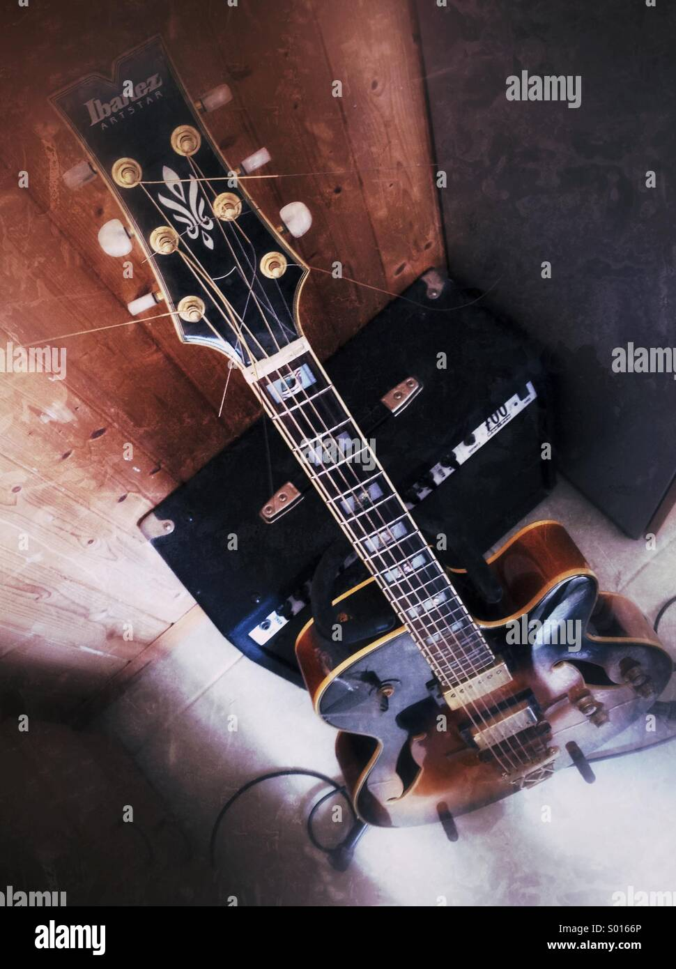 Semi-acoustic jazz guitar with amplifier. - Stock Image