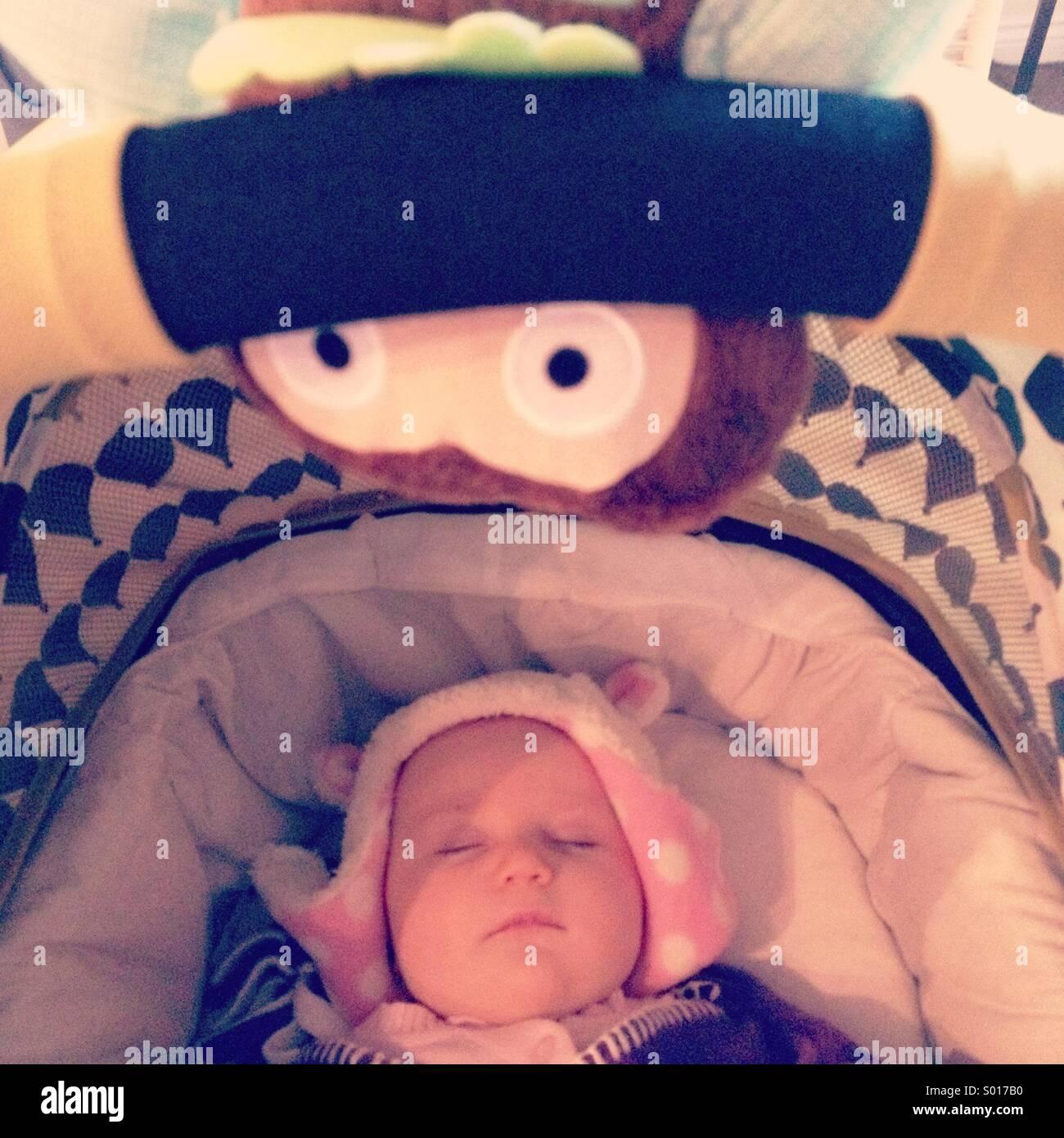Sleeping baby and baby toy - Stock Image