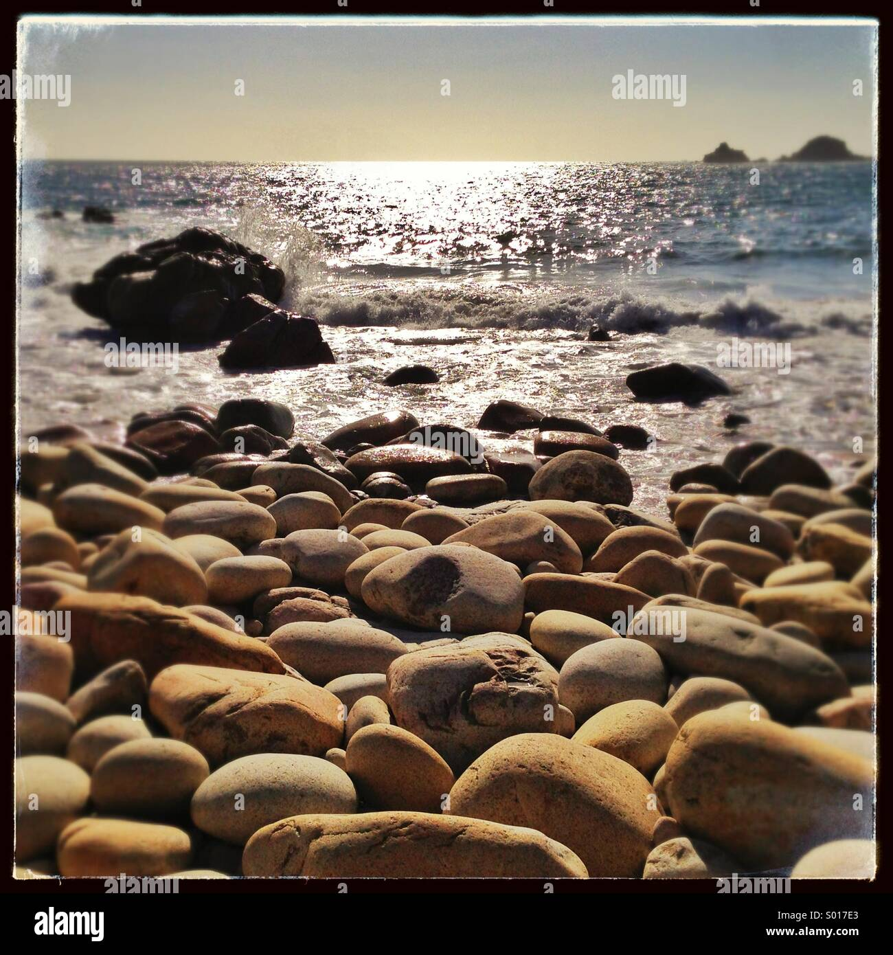 Pebbly beach with big stones - Stock Image