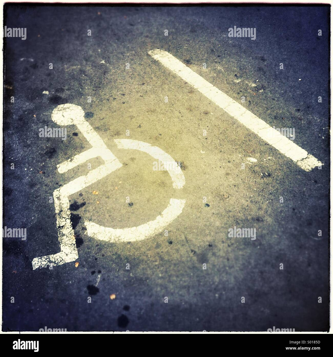Handicapped disabled sign parking on road - Stock Image