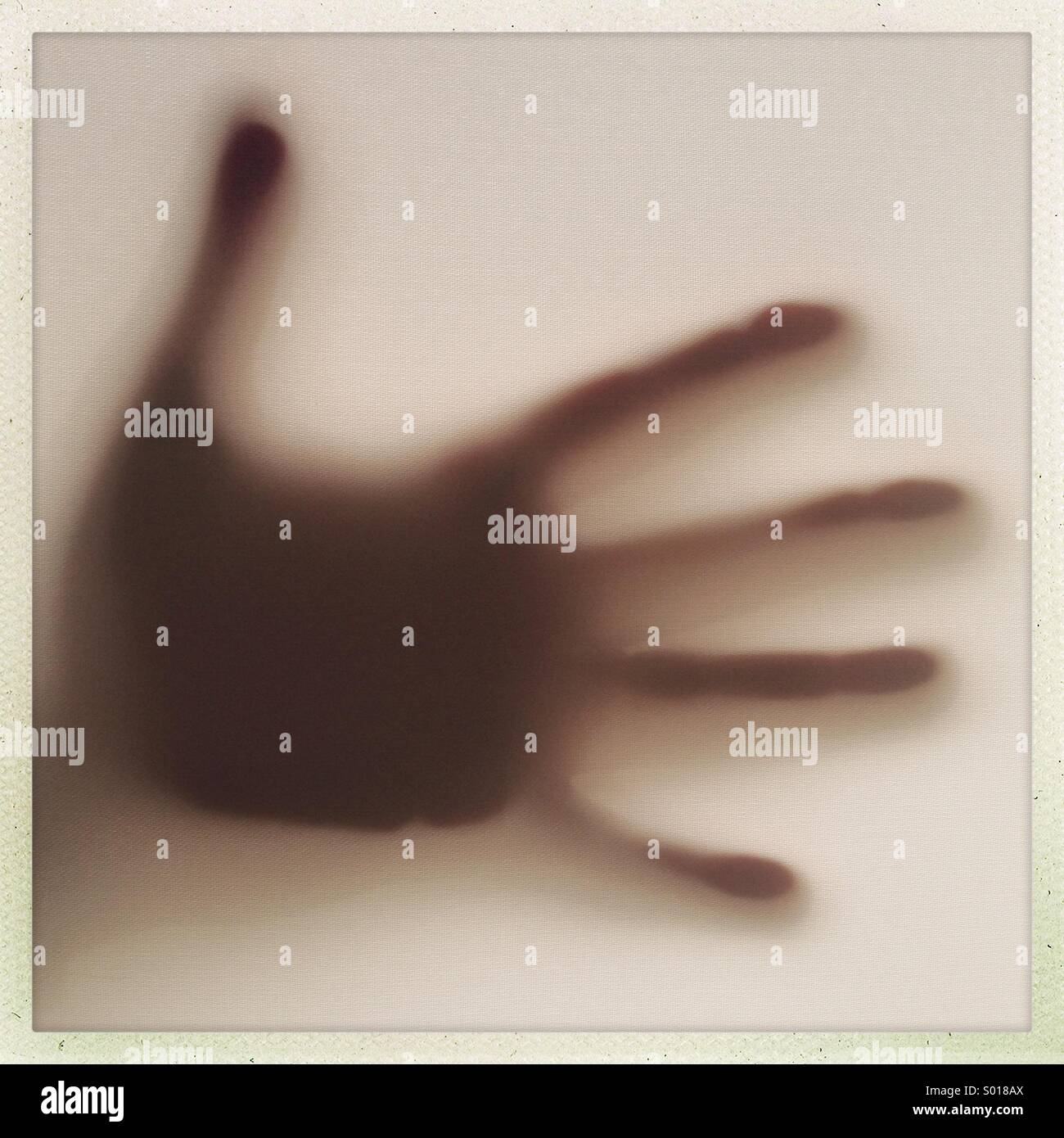 Hand silhoutte on window - Stock Image