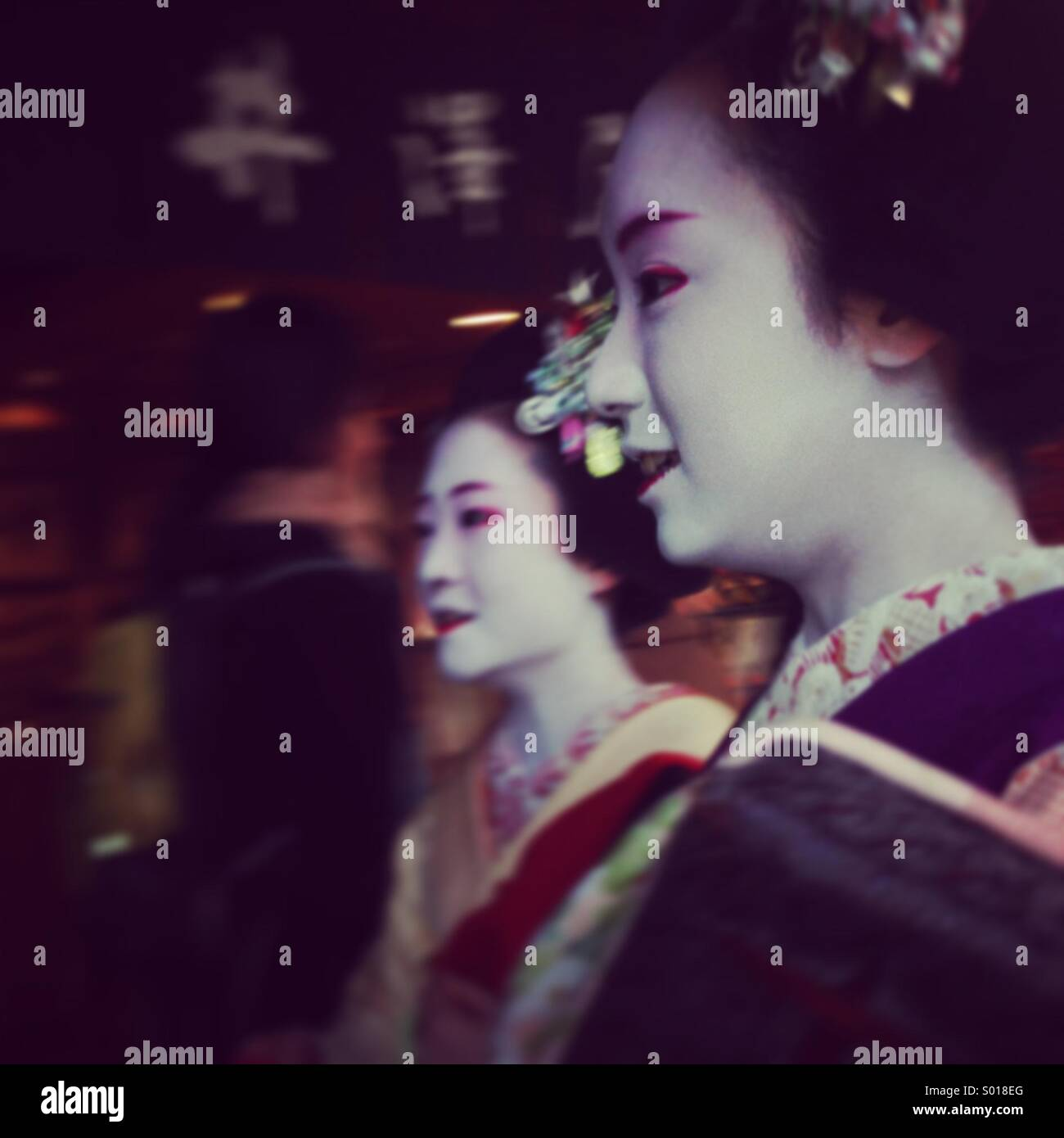 2 geisha girls on their way out in Kyoto Stock Photo
