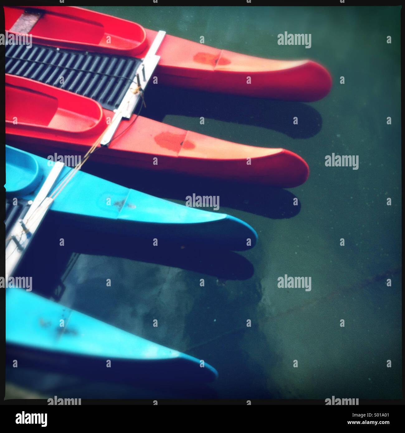Colourful kayaks - Stock Image
