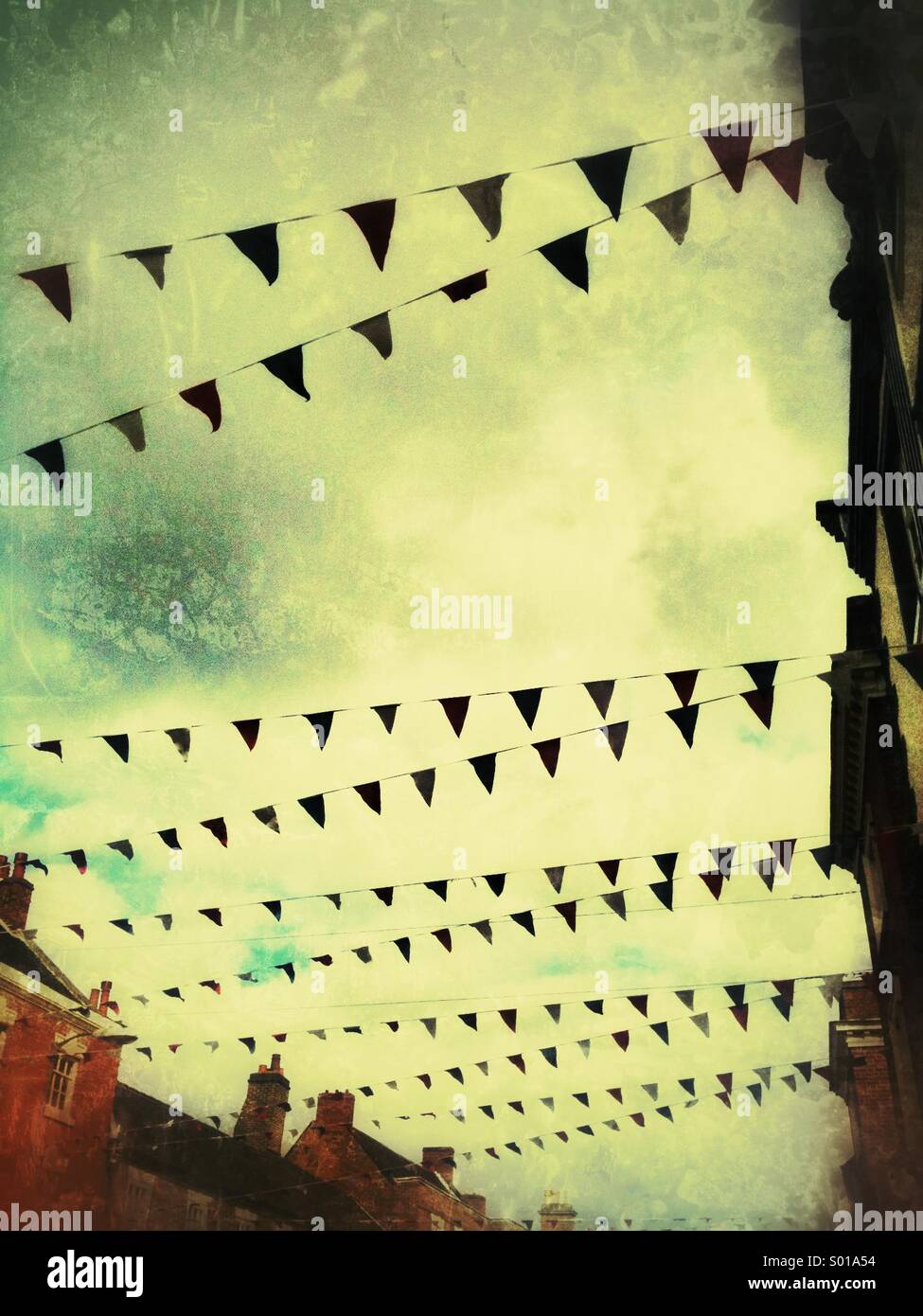 Bunting in a street scene with a grunge effect. - Stock Image