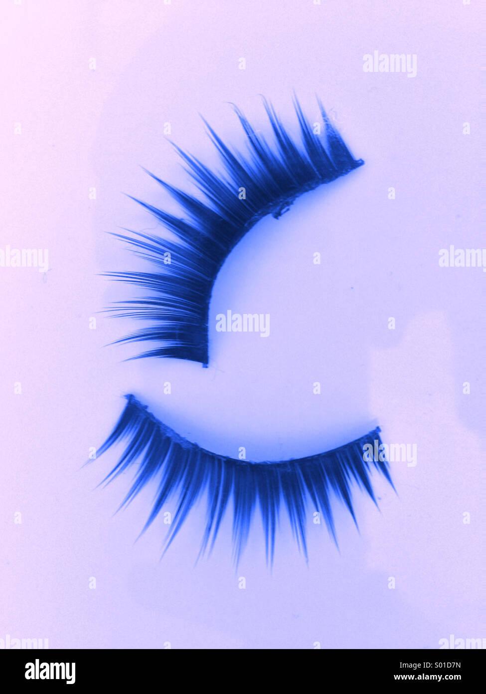 Blue eyelashes - Stock Image