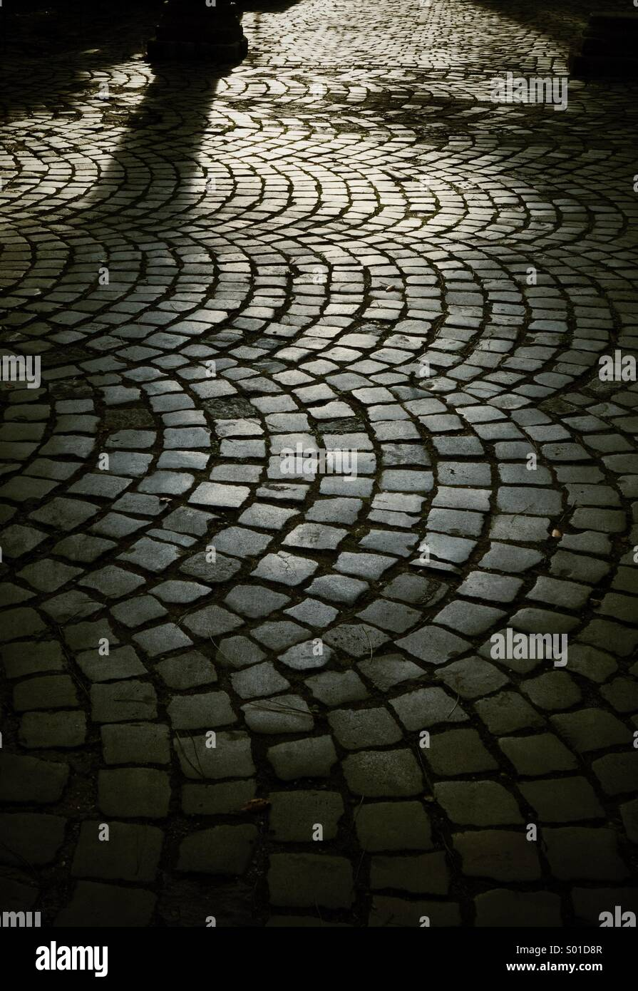 Sunlight on cobbles in Rome, Italy - Stock Image