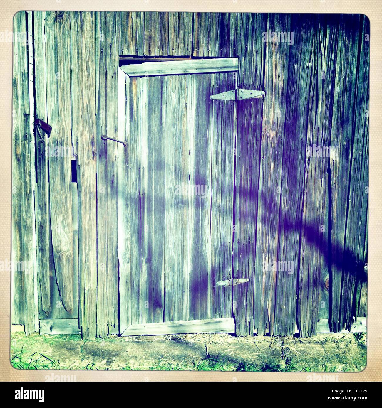 Weathered barn door. - Stock Image