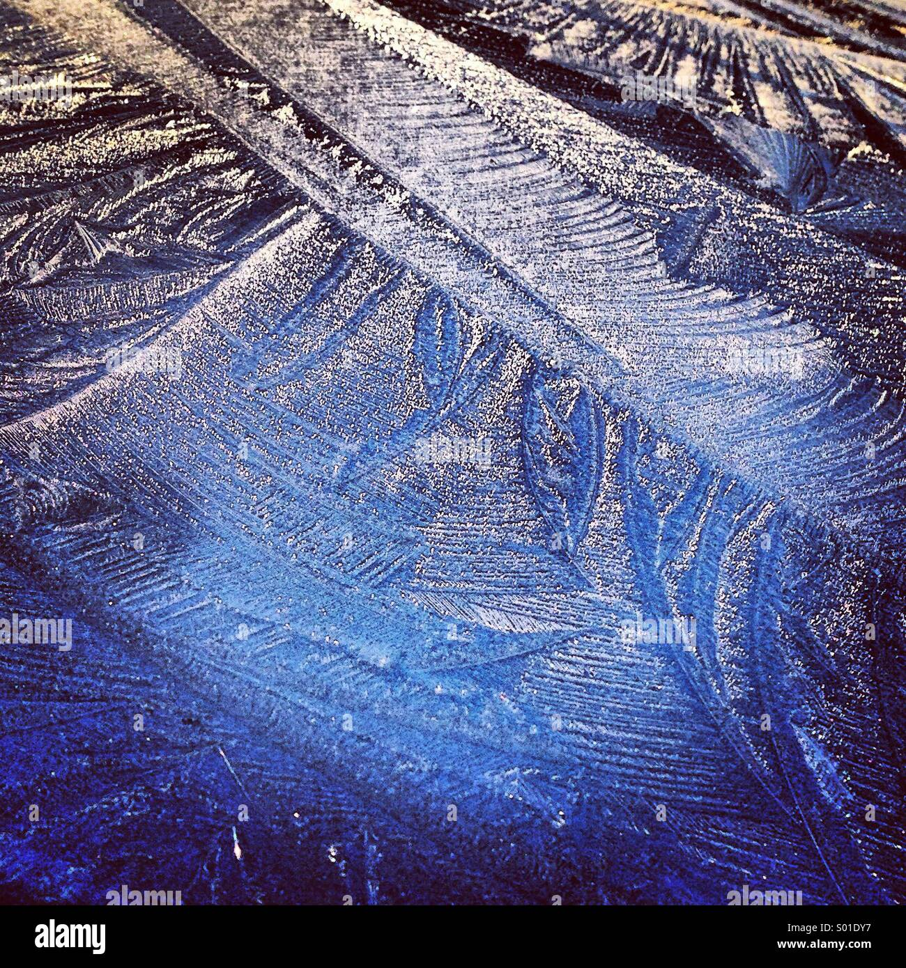 Ice patterns on a car roof - Stock Image