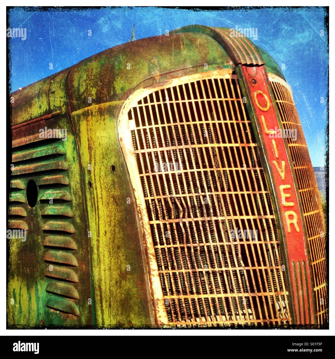 1940's Era Oliver Tractor Hood Detail with Grunge Texture Overlay - Stock Image