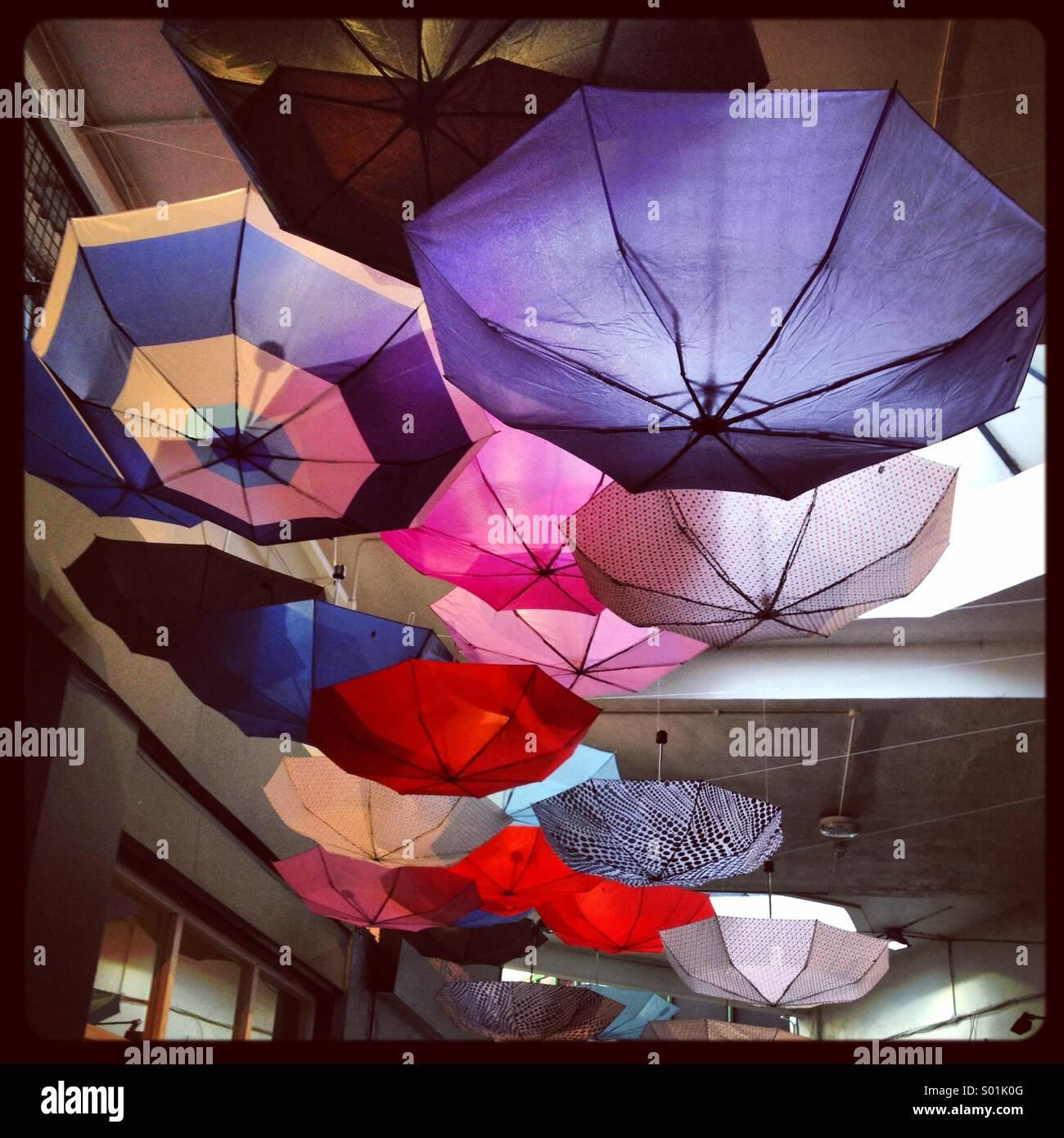 Umbrellas hanging upside down in Brixton Village London. - Stock Image