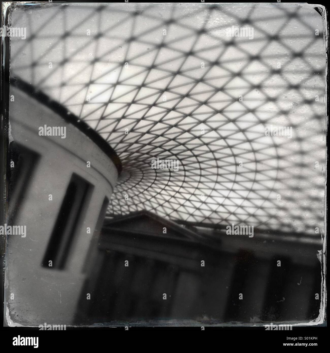 Glass roof covering the British Museum Great Court in London, UK. Designed by Foster and Partners, the roof transformed - Stock Image