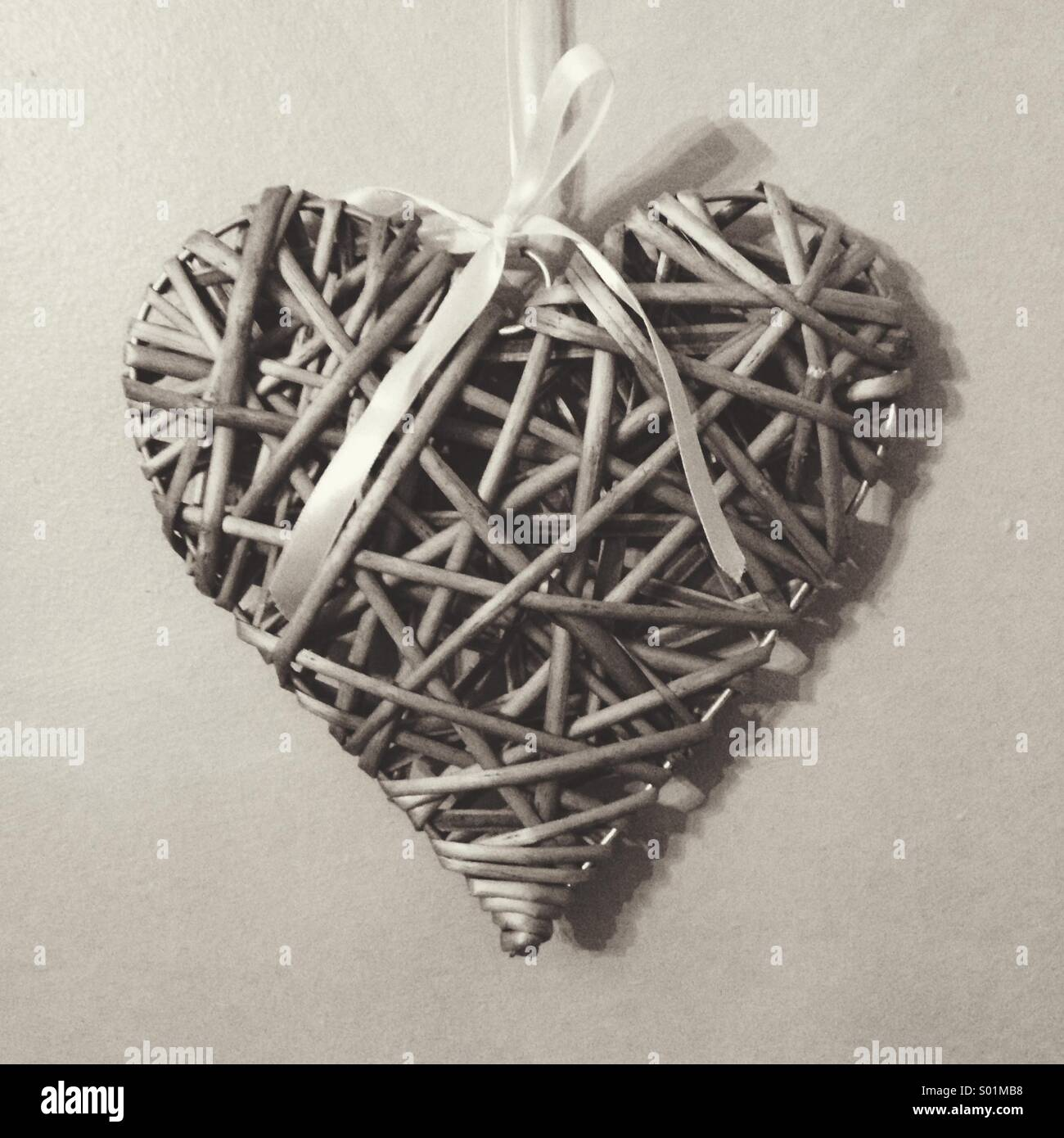 What looks to be a simple heart, can soon become entangled with love, and love that never dies. - Stock Image