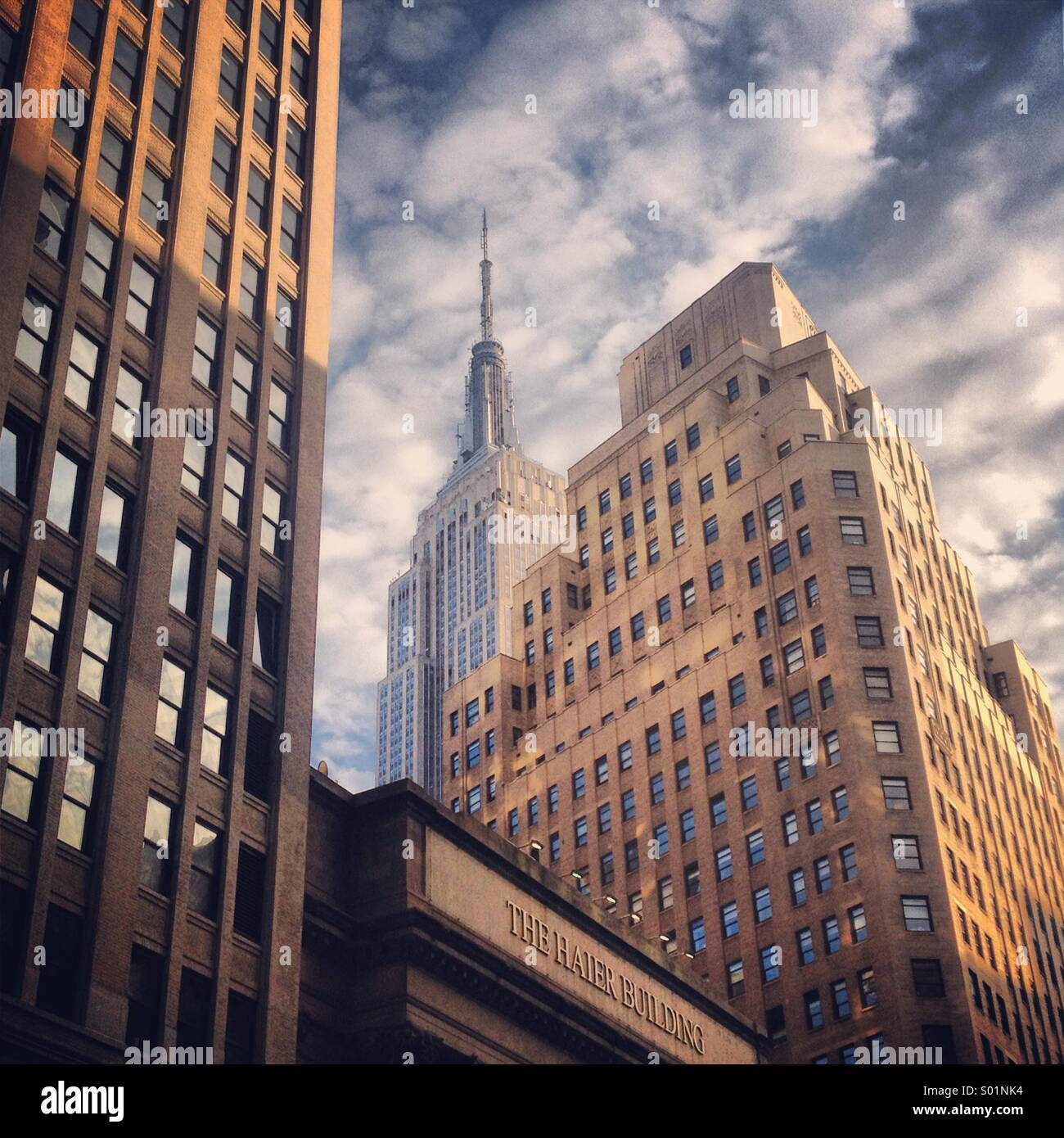 Empire State Building in the Skyrise Crowd Stock Photo