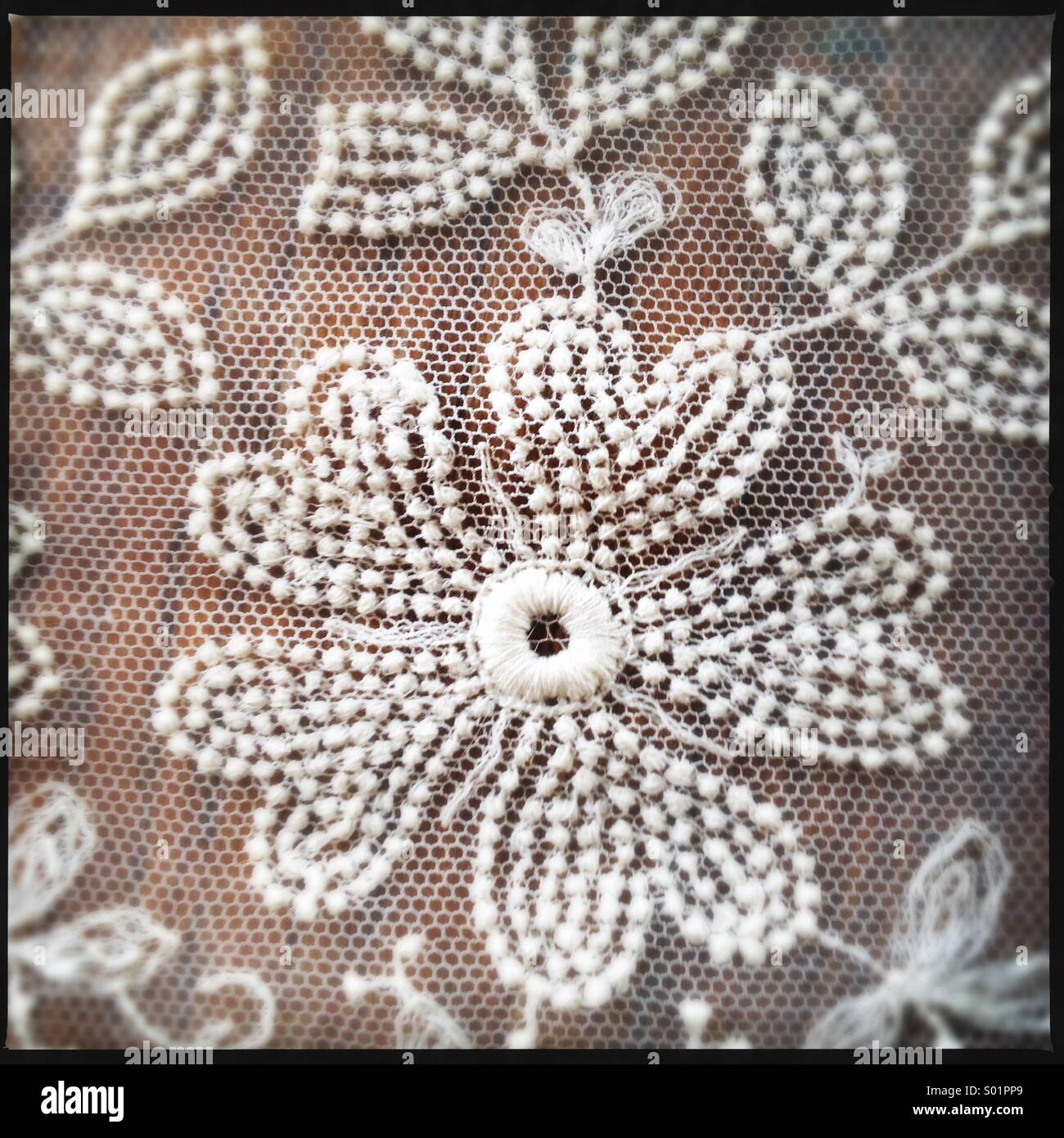 Antique Lace on Wood Surface - Stock Image