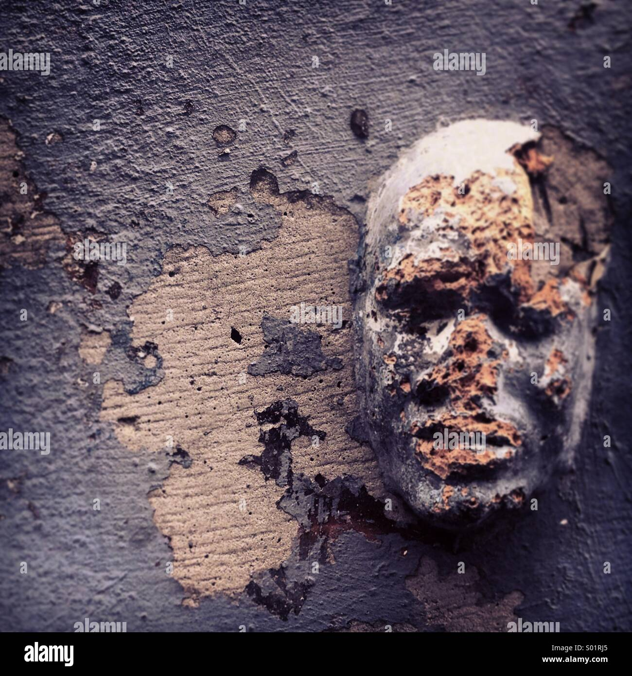 face in the wall - Stock Image