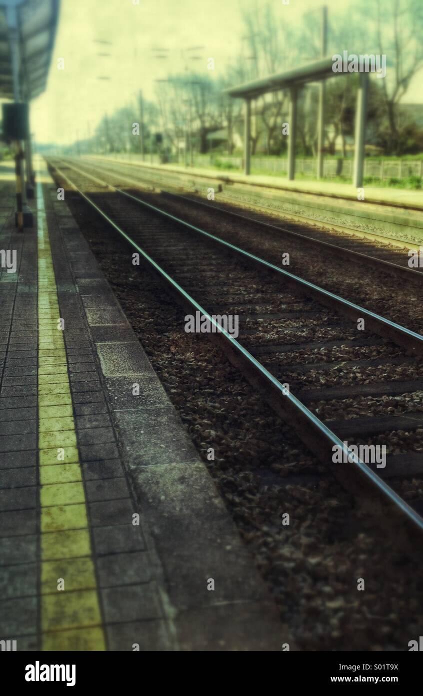 Train platform, train lines - Stock Image