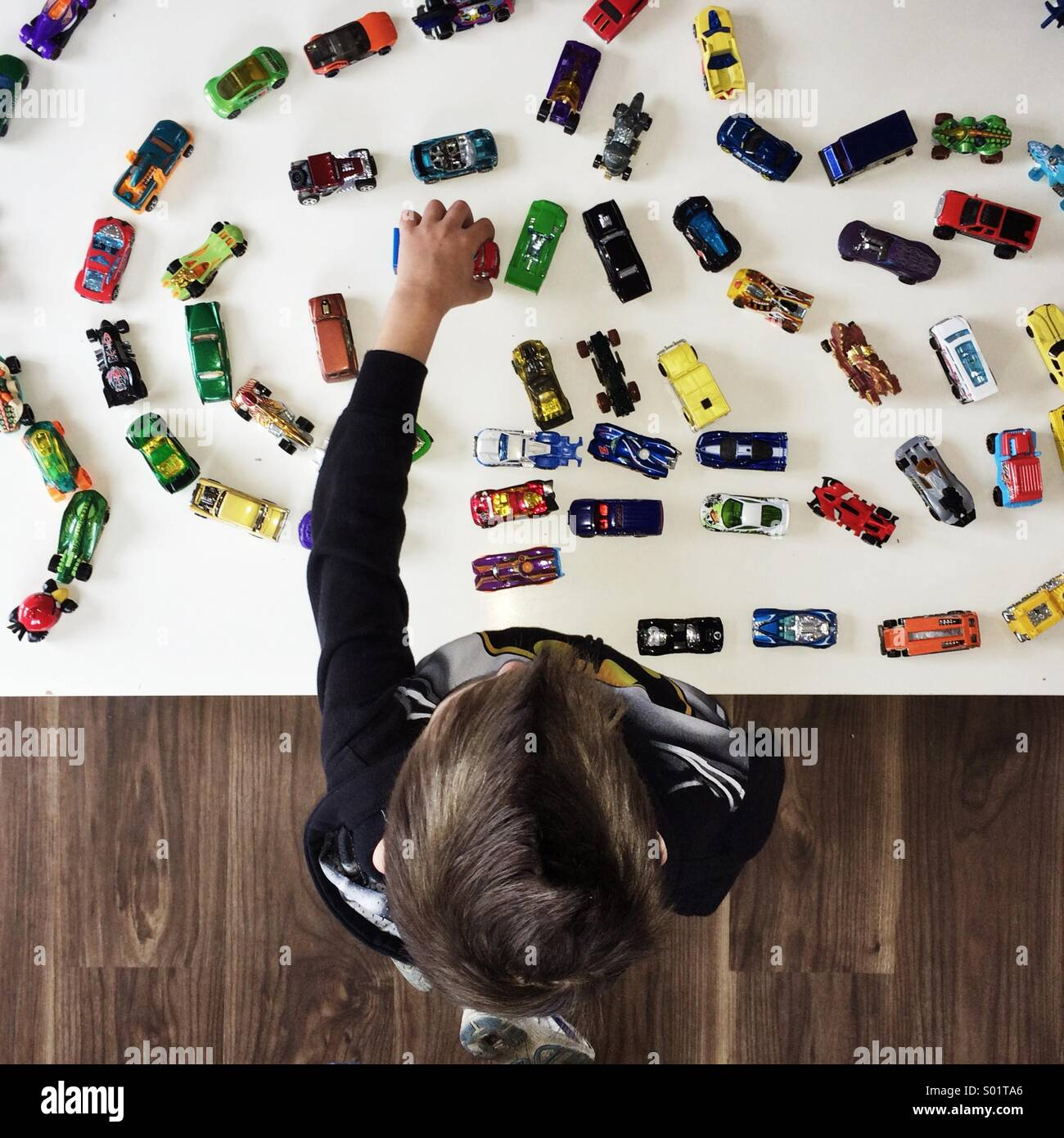 Boy playing wit toy cars - Stock Image