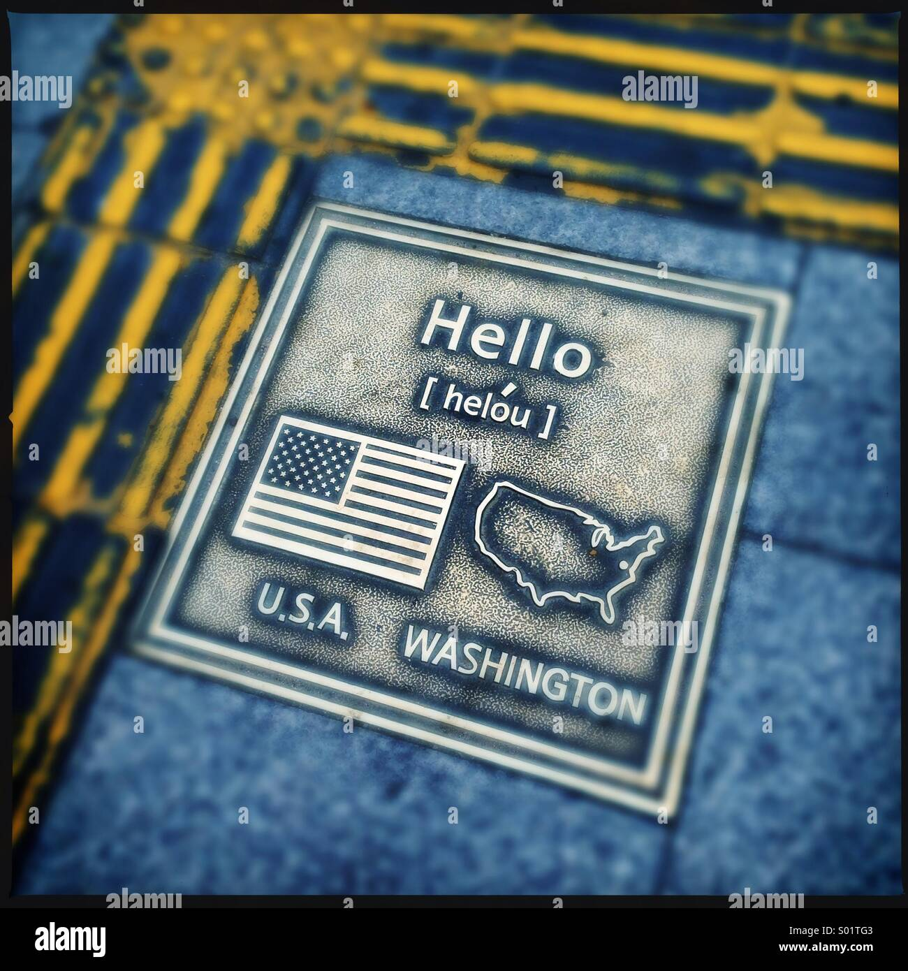 Brass plate on sidewalk showing hello ,flag and map. Seoul,Korea - Stock Image
