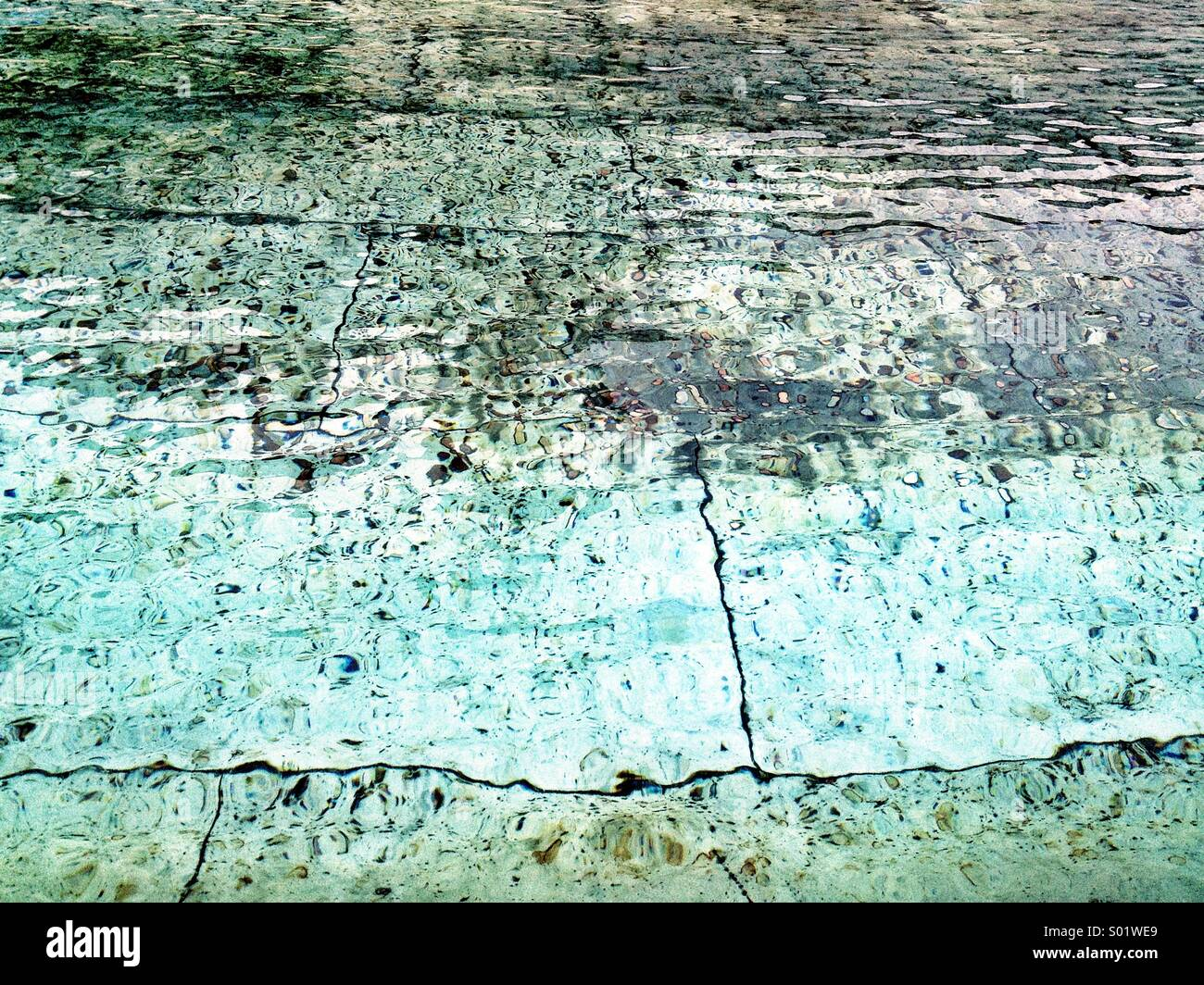 Turquoise water and stone texture Stock Photo