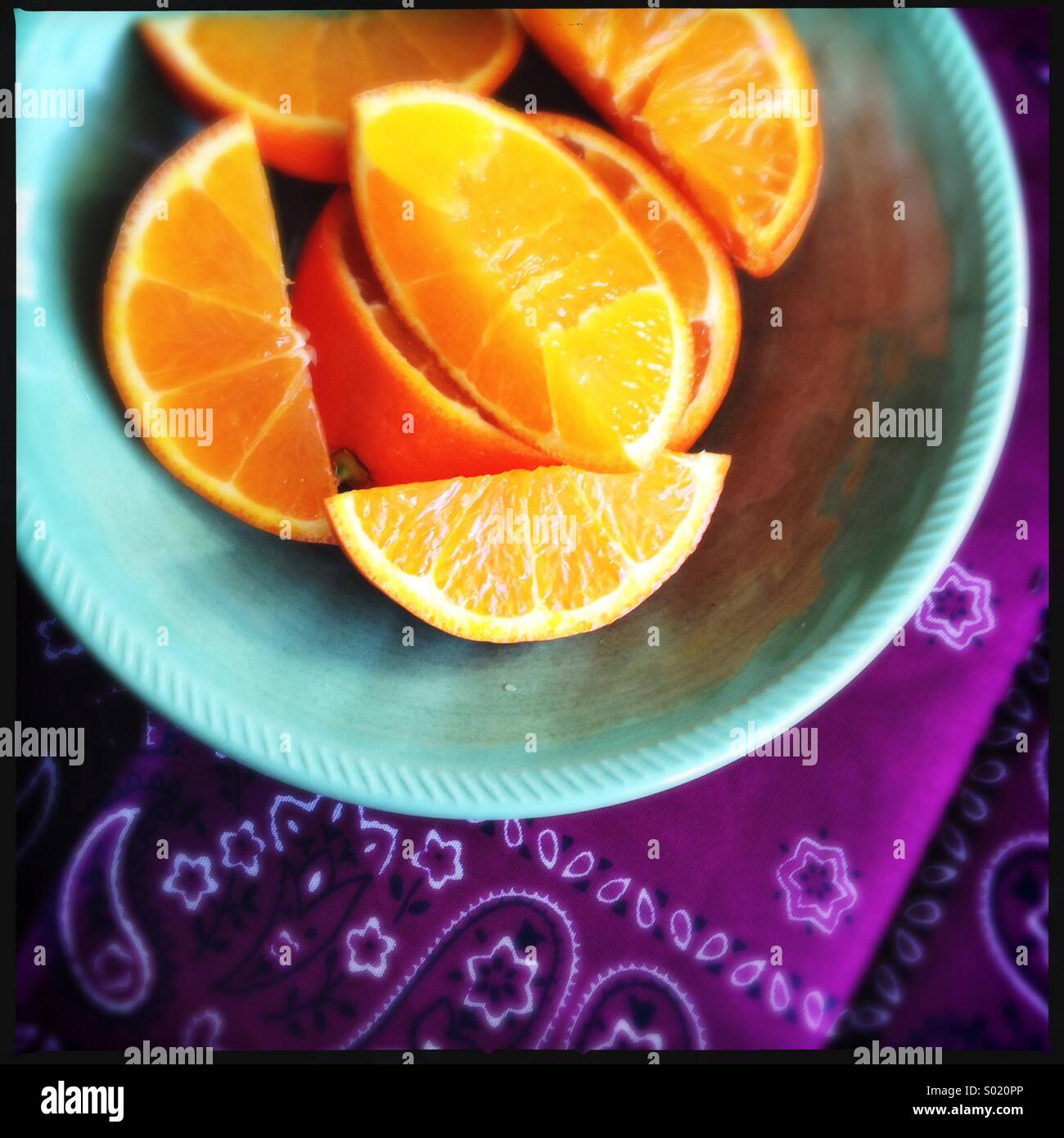 Orange Wedges in Bowl - Stock Image