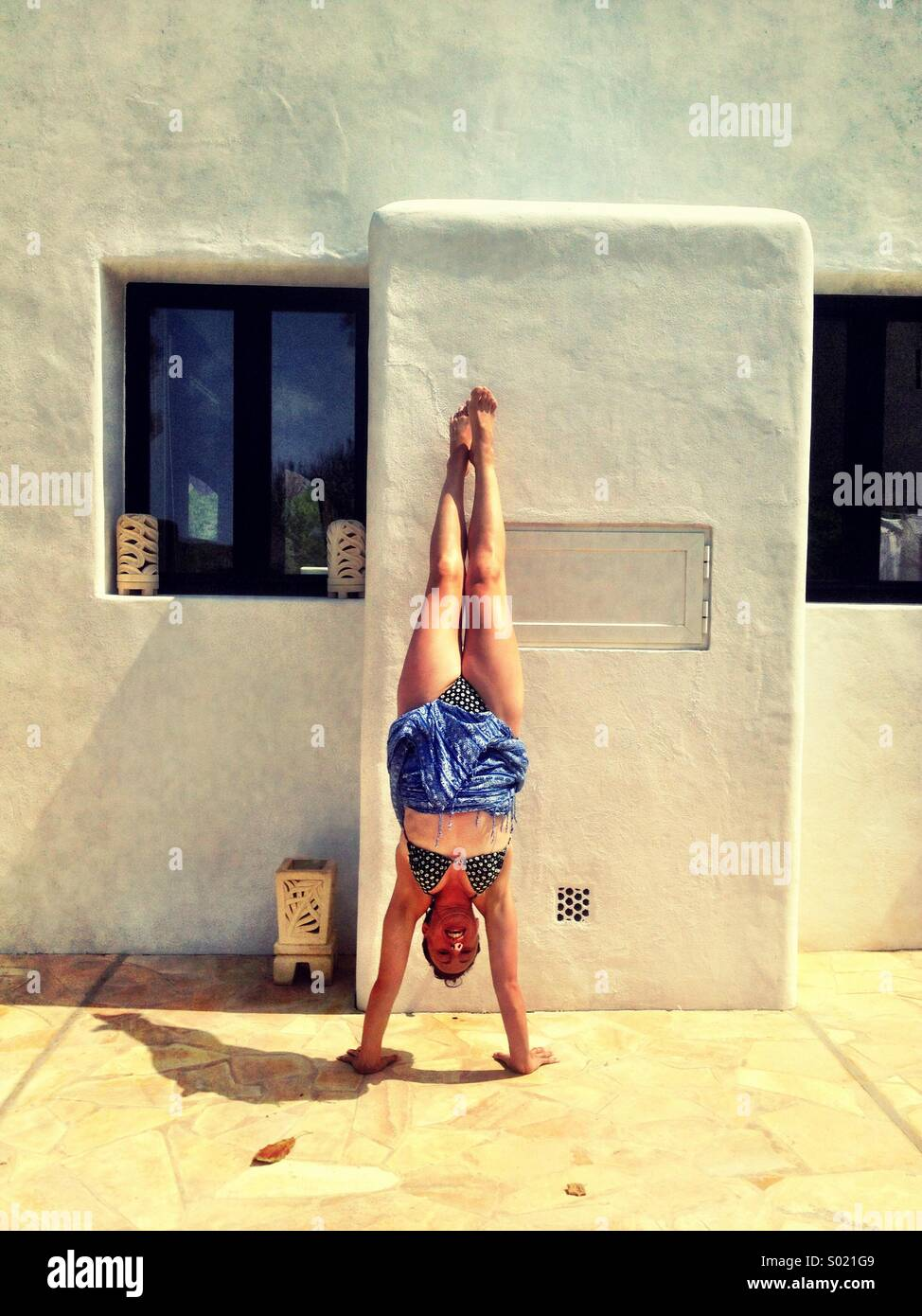 Handstand in Ibiza - Stock Image