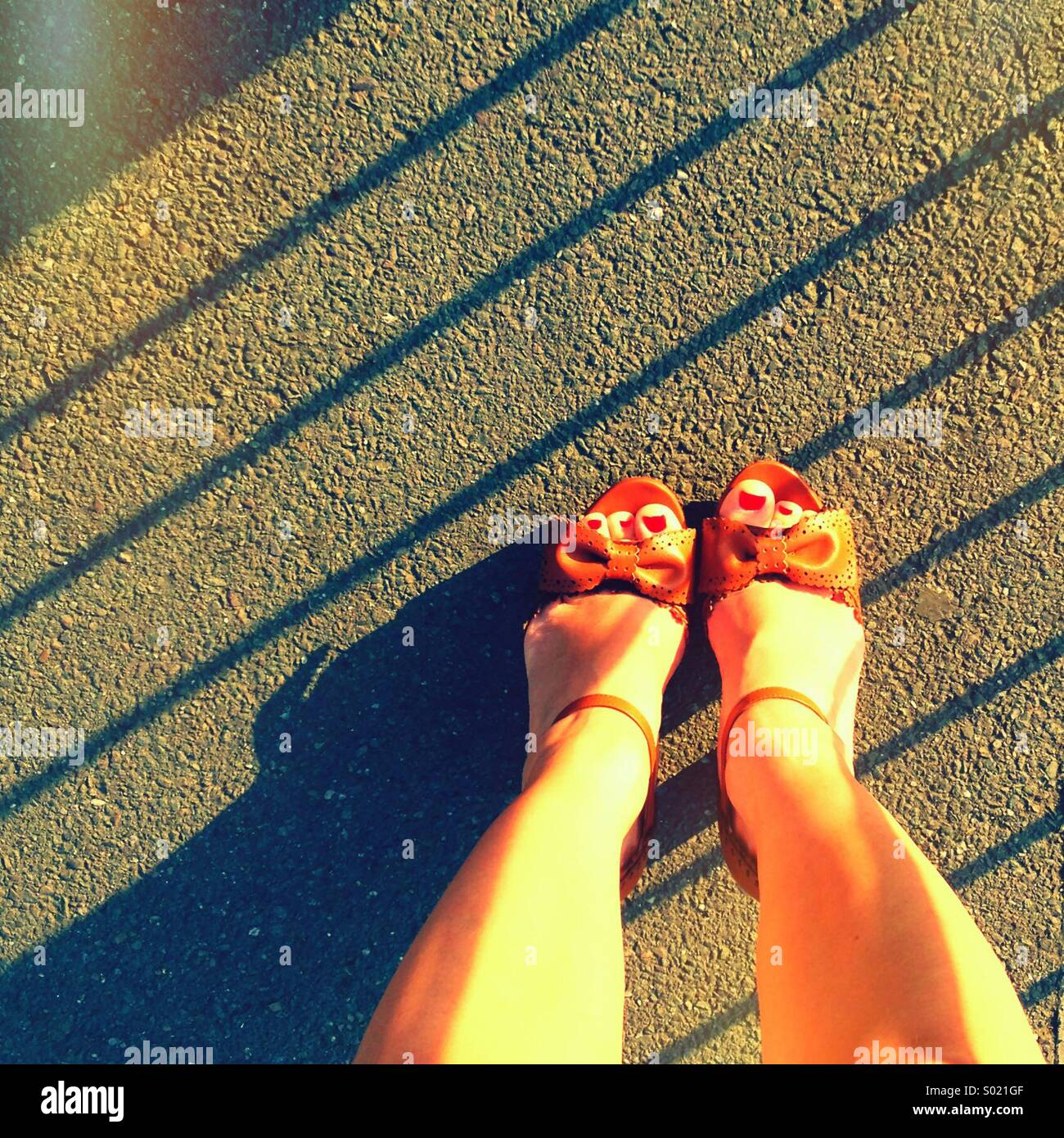 Girls shoes with red toenail polish Stock Photo