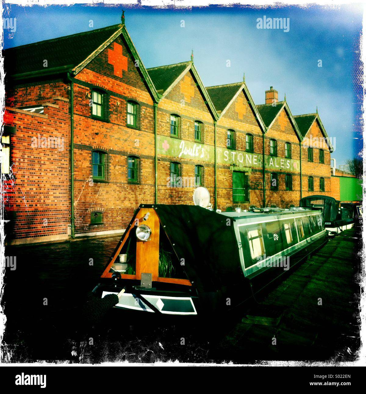 Narrowboat in front of Joule's brewery, Stone, Staffordshire. - Stock Image
