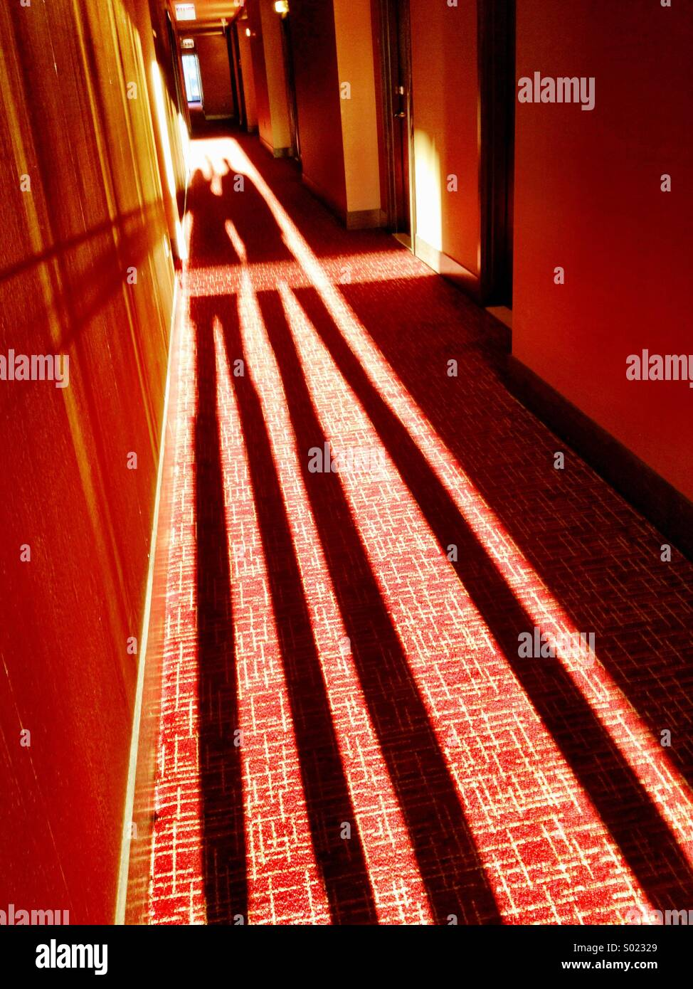 Long shadows in hallway - Stock Image