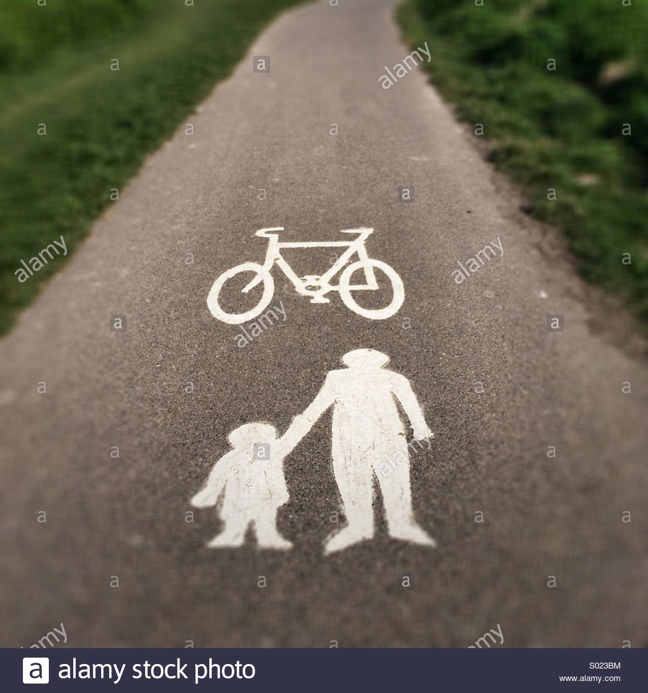 Cycling & Walking Path with adult & Child Symbols - Stock Image