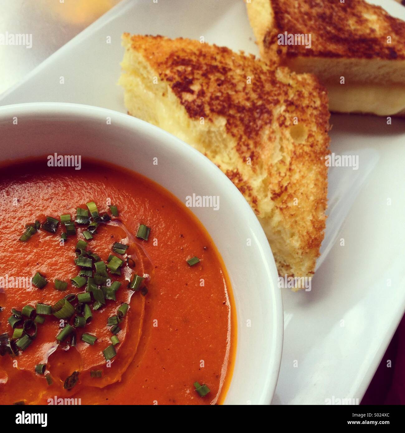 Grilled cheese and tomato soup - Stock Image