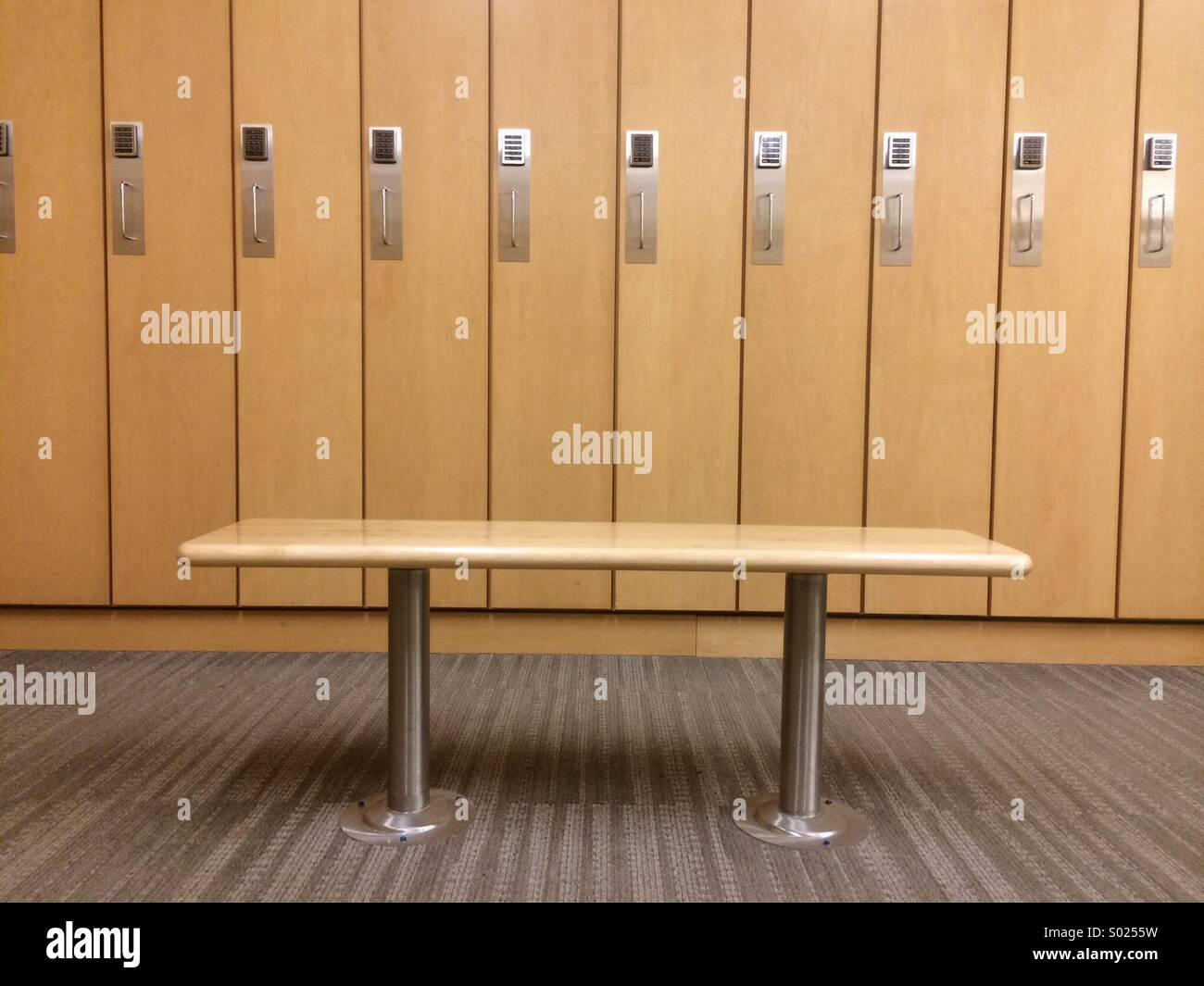 Bench and lockers in a fitness facility. - Stock Image