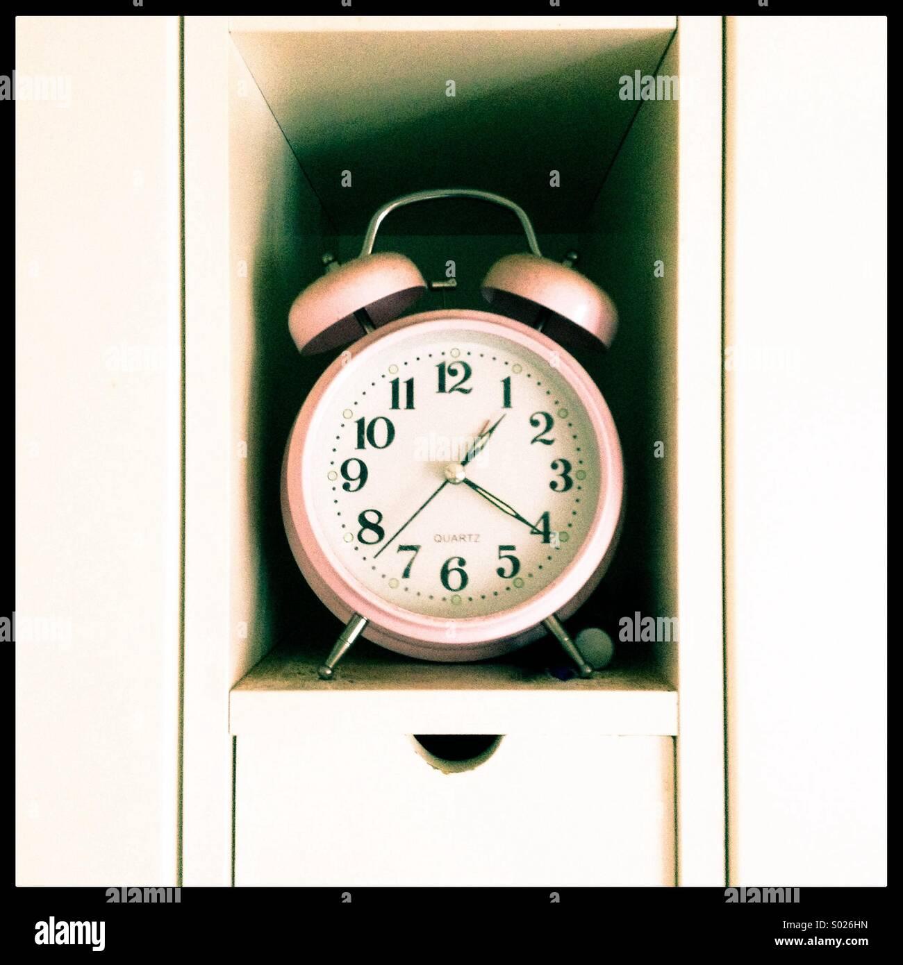 Pink alarm clock - Stock Image