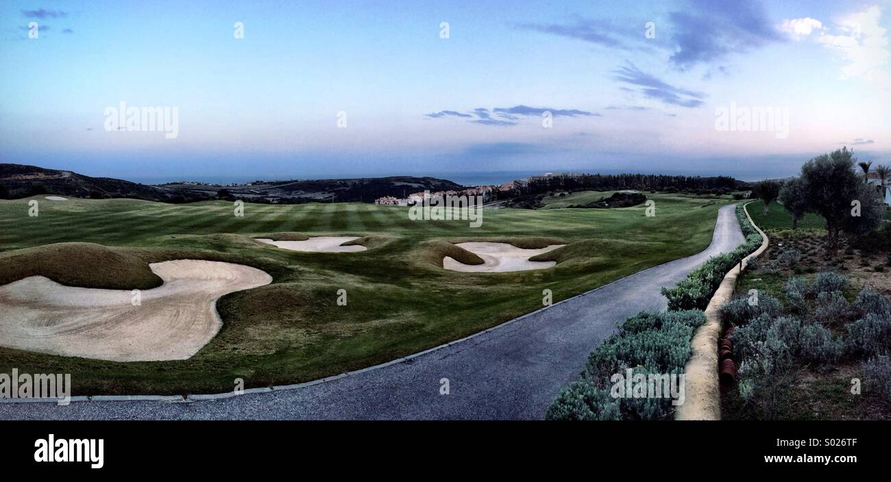 Absolutely stunning panorama picture of a golf course with a fading path and beautiful sky. - Stock Image