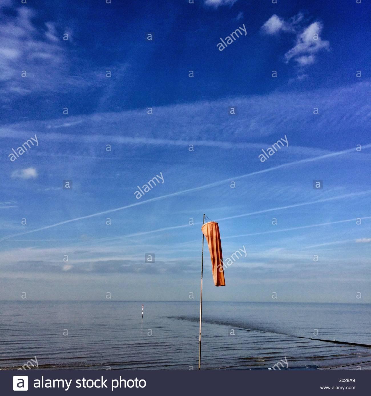 Orange Windsock Blue Sky Sea & Beach Calm - Stock Image