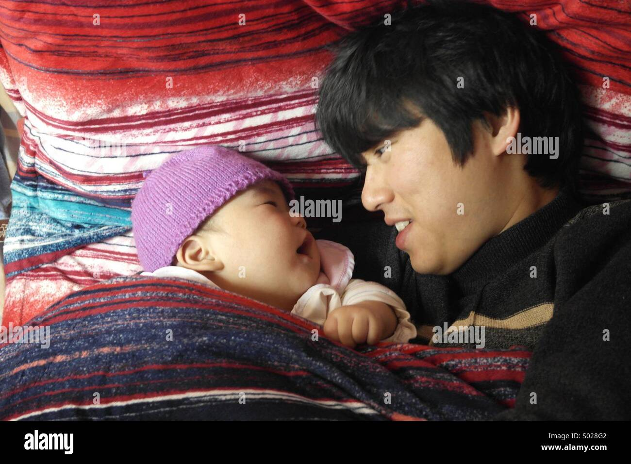 Asian father and son,6 months baby - Stock Image