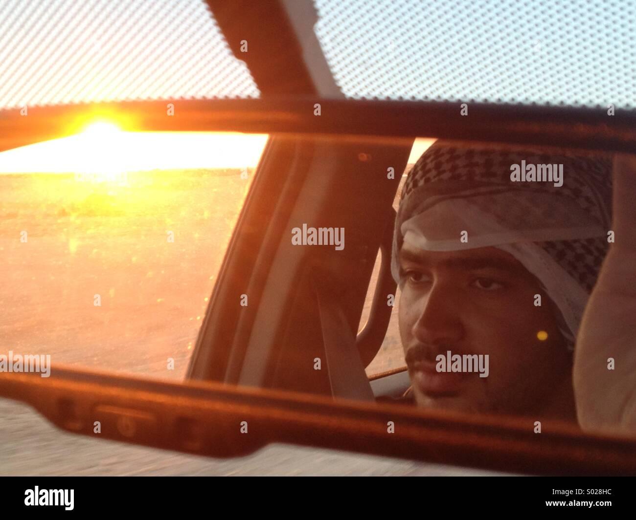 Egyptian man driving at sunset - Stock Image