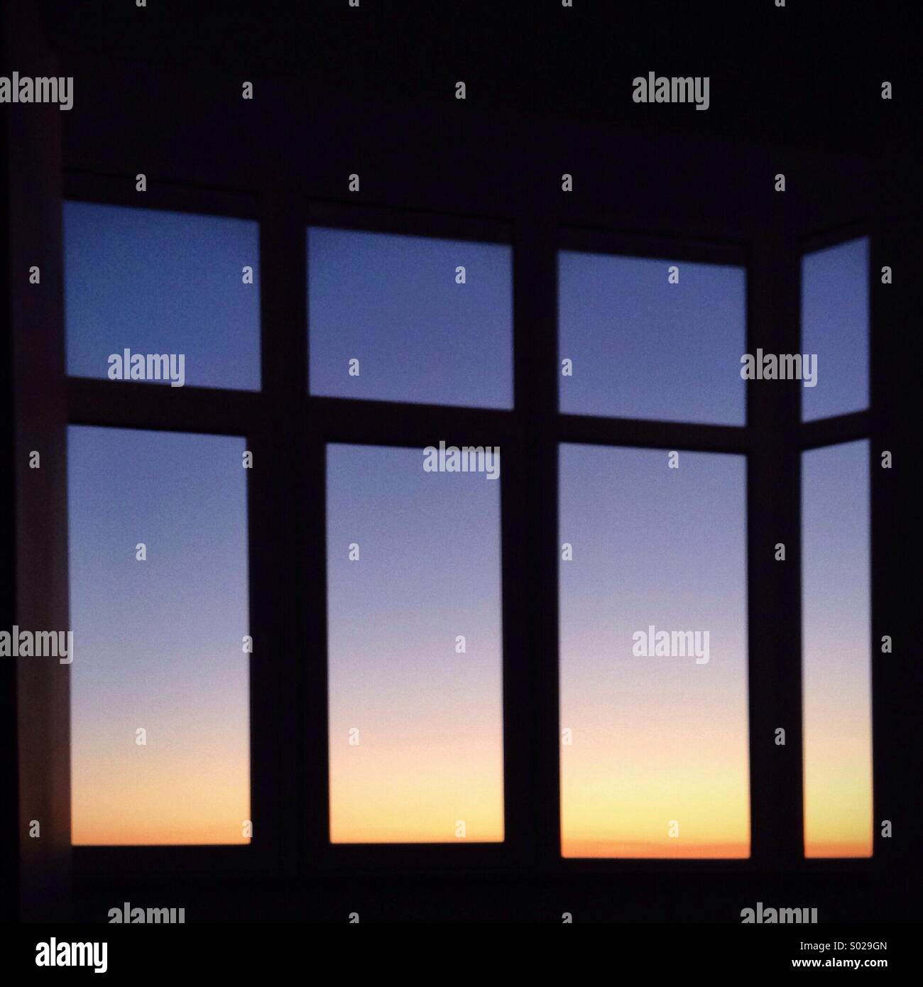 Sunset sky in window - Stock Image