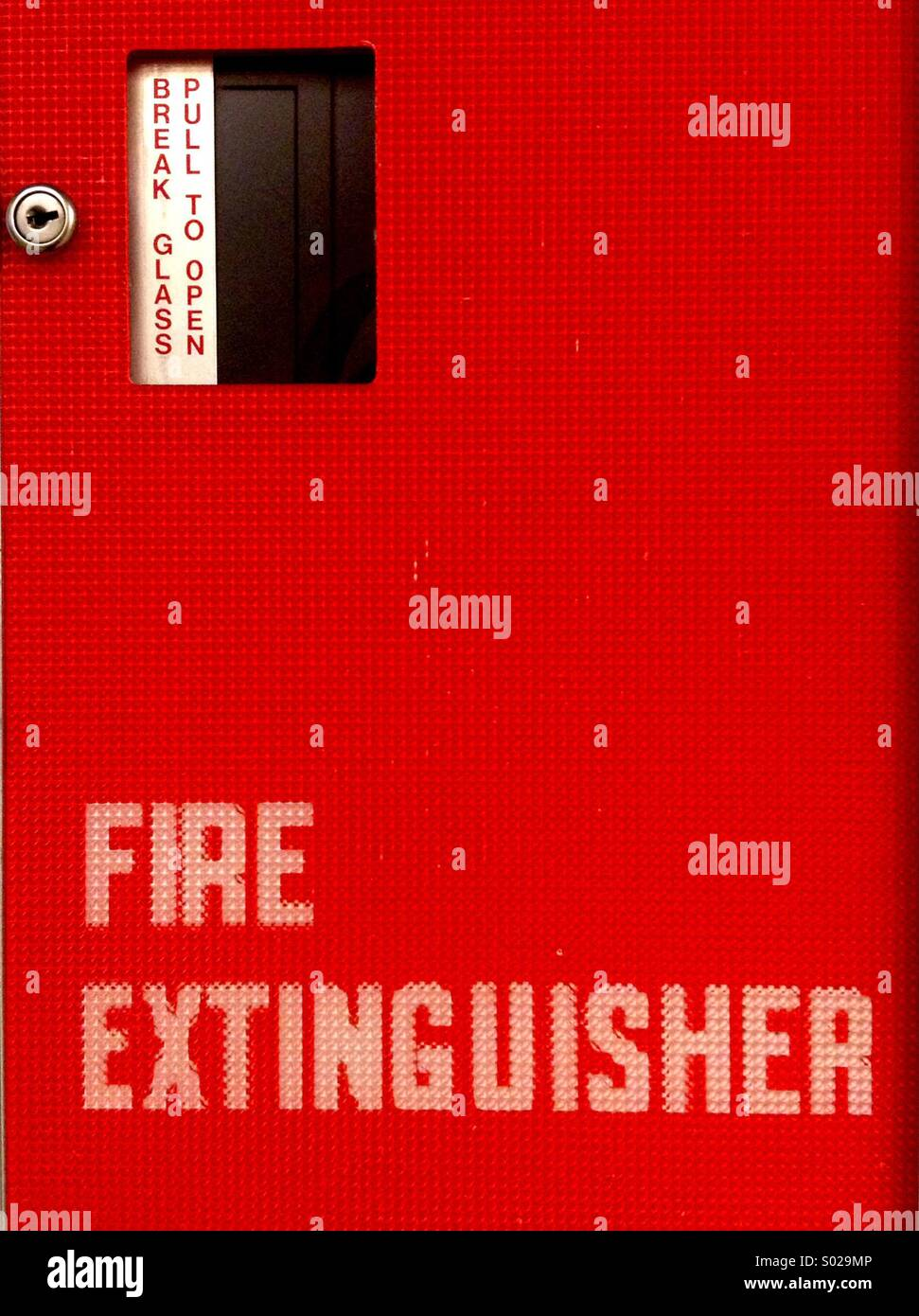 Fire extinguisher. Break to open. - Stock Image