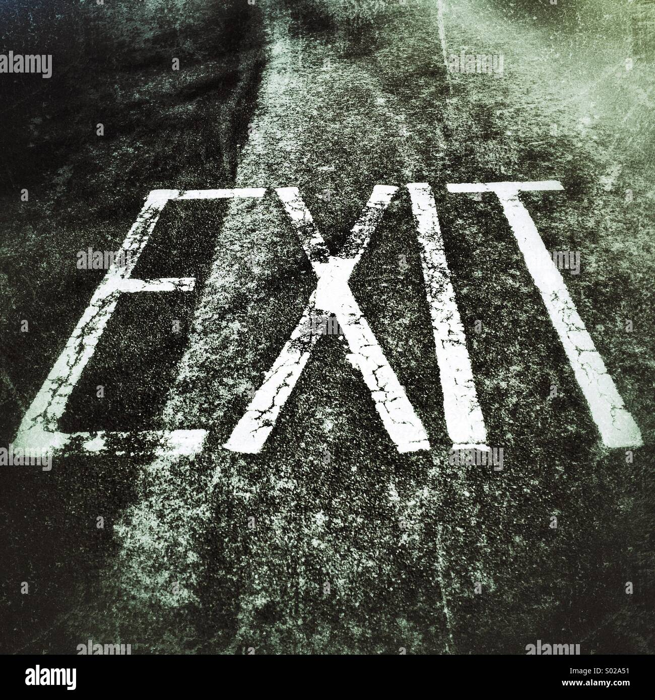Exit sign painted on road surface - Stock Image