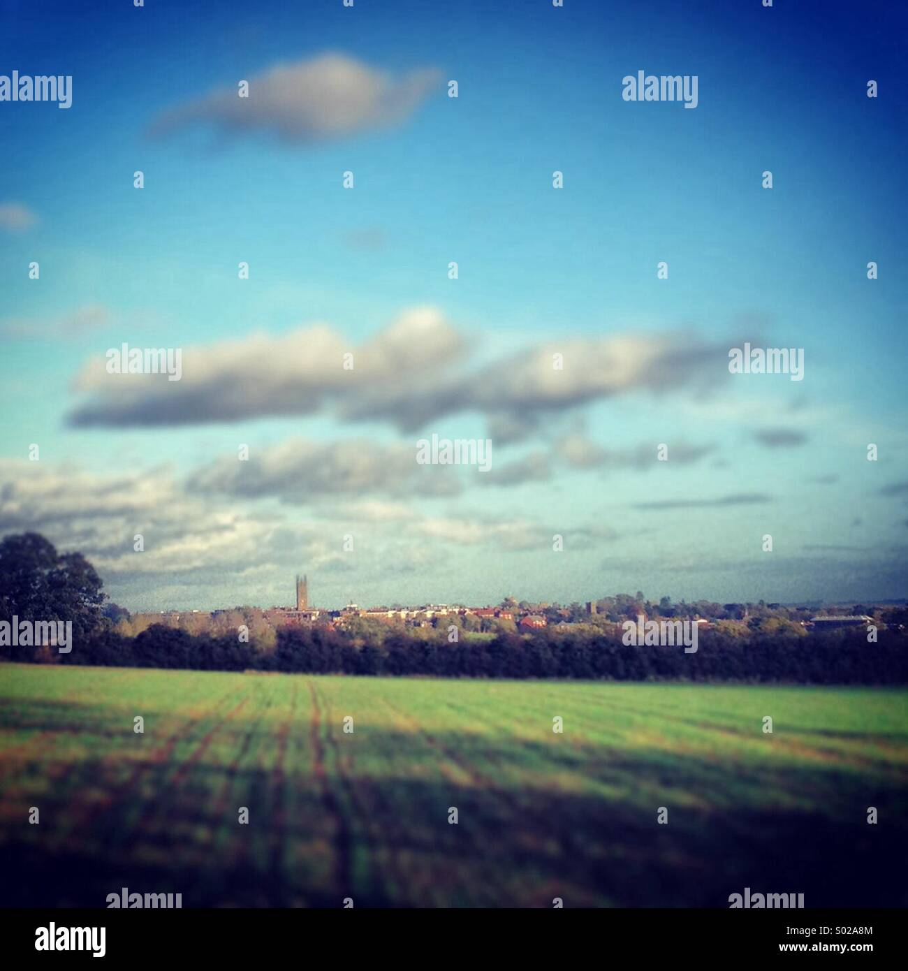The town of Warwick, UK, seen from Hampton Magna on a sunny autumn afternoon - Stock Image