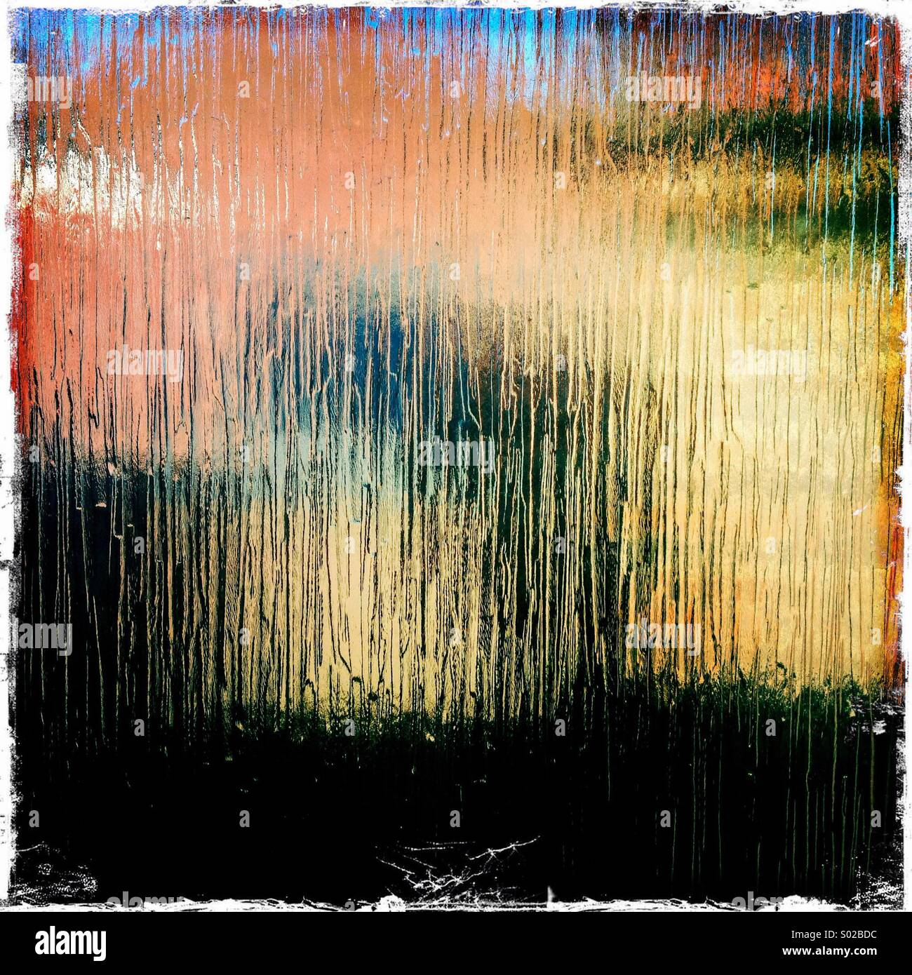 Abstract photo. Looking through an obscure glass window. - Stock Image